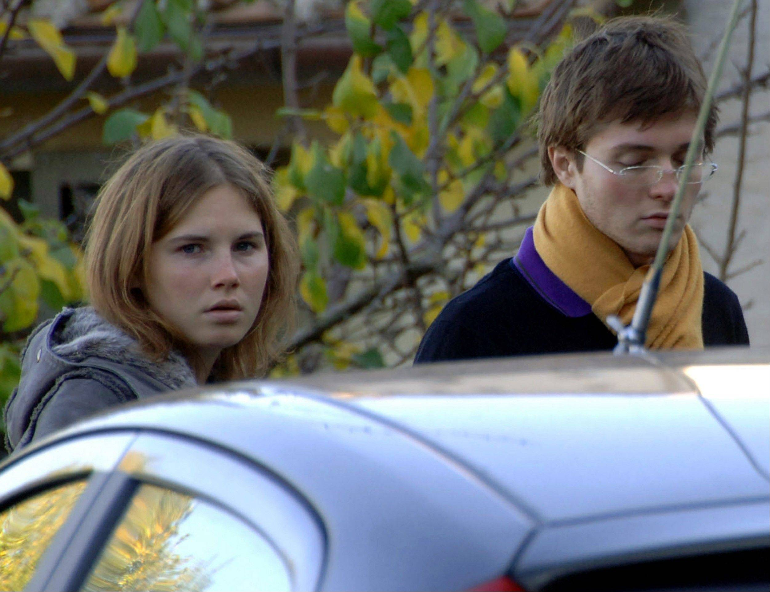 Amanda Knox, left, and Raffaele Sollecito, stand outside the rented house where 21-year-old British student Meredith Kercher was found dead in 2007. The state�s prosecutor is arguing his case that an appeals court should reinstate the guilty verdict against U.S. exchange student Amanda Knox for the grisly 2007 murder of her roommate.