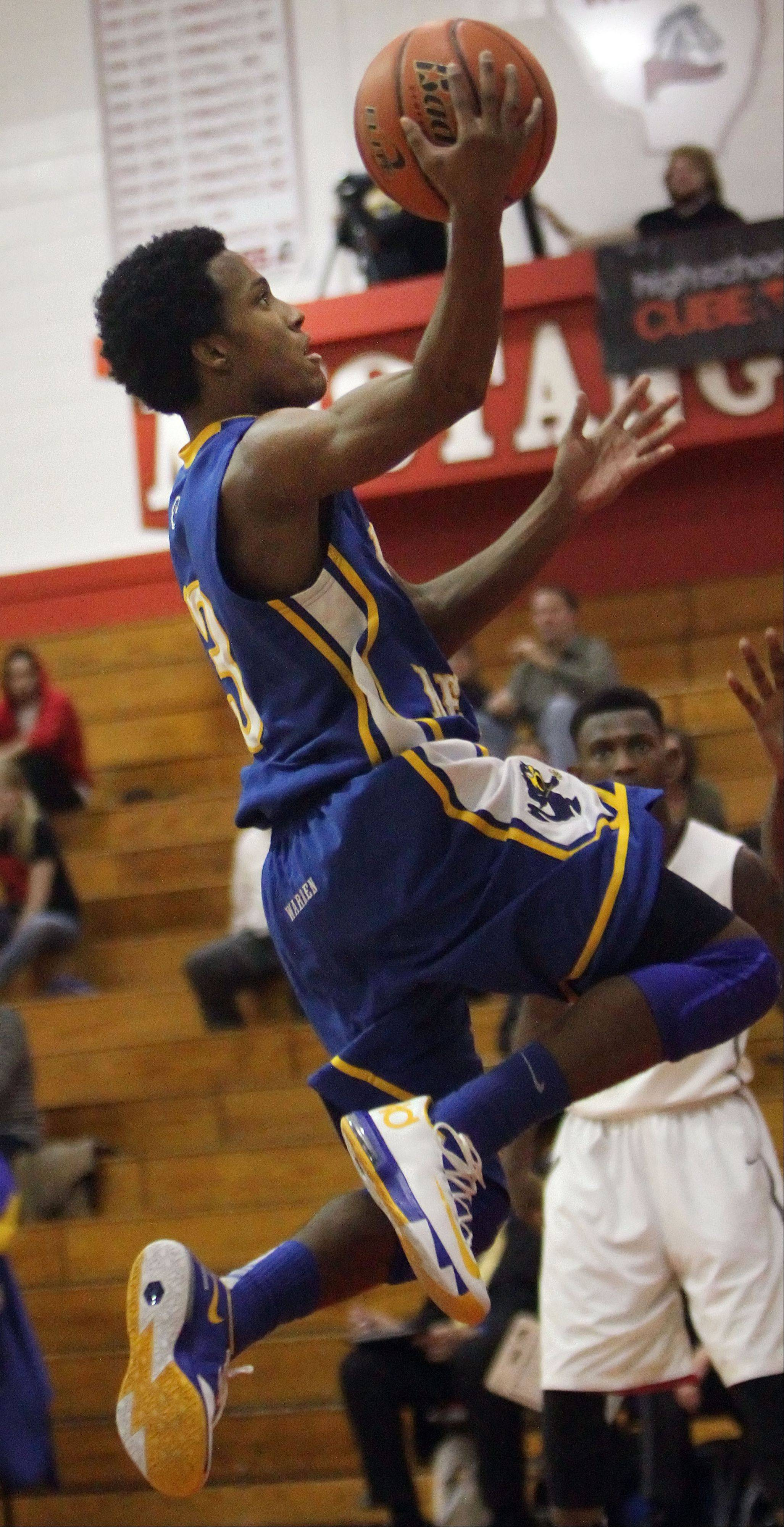 Warren�s Eric Gillespie drives to the hoop during the Blue Devils� loss to Uplift on Tuesday at Mundelein.