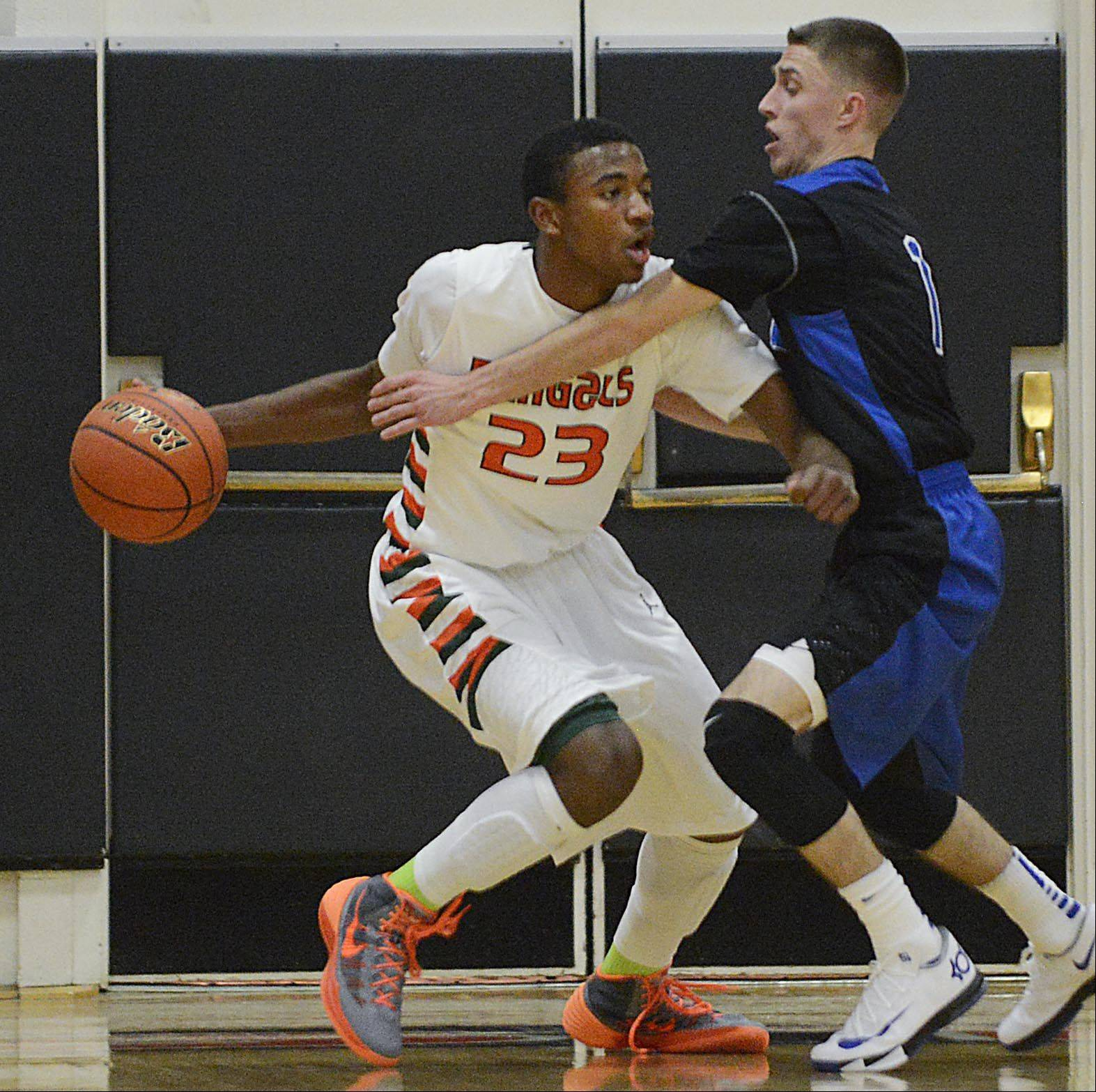St. Charles North�s Alec Goetz guards Plainfield East�s Aaron Jordan Tuesday in St. Charles.
