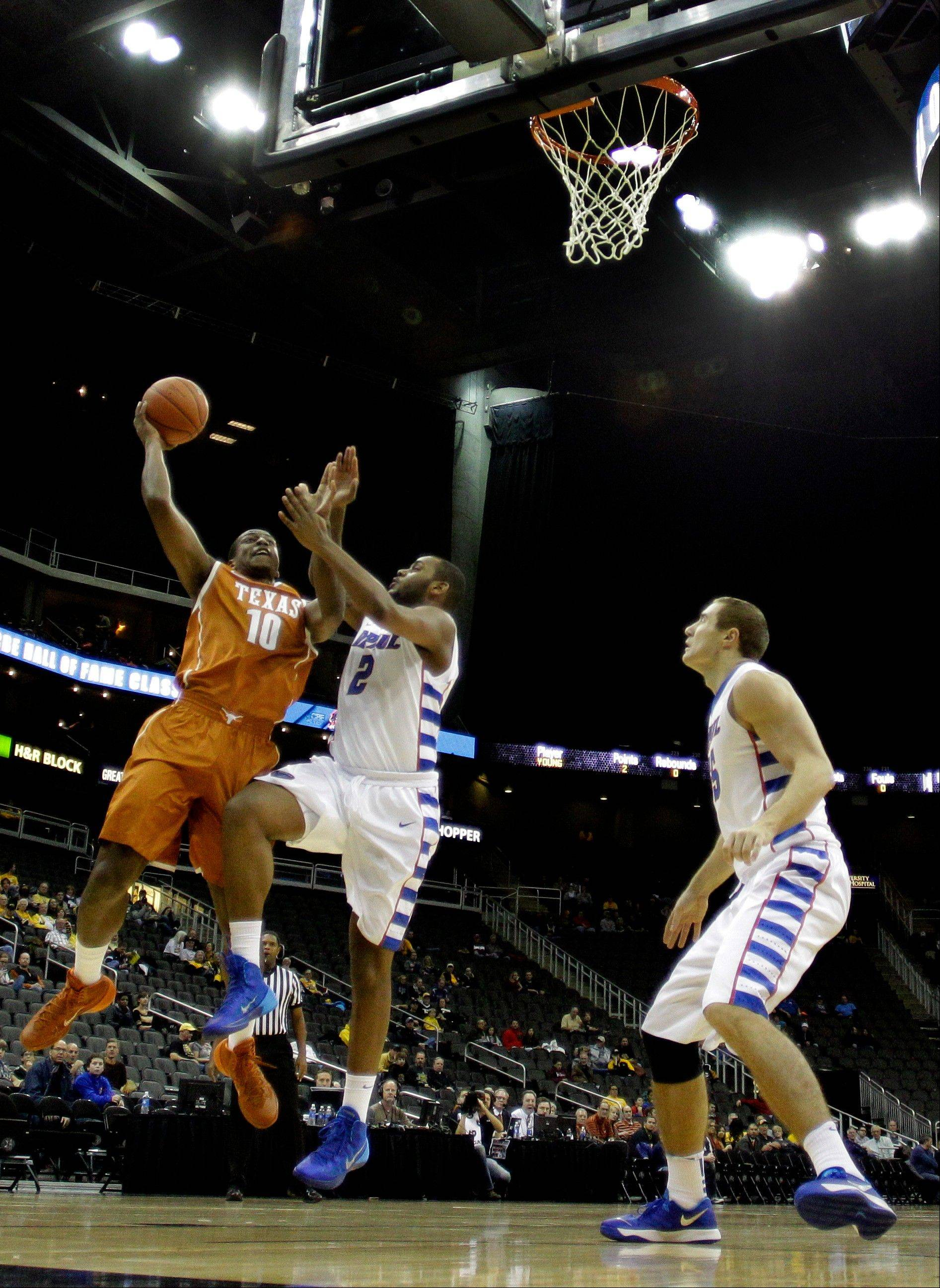 Texas' Jonathan Holmes (10) gets past DePaul's Tommy Hamilton IV (2) to put up a shot during the first half of an NCAA college basketball game Tuesday, Nov. 26, 2013, in Kansas City, Mo. (AP Photo/Charlie Riedel)