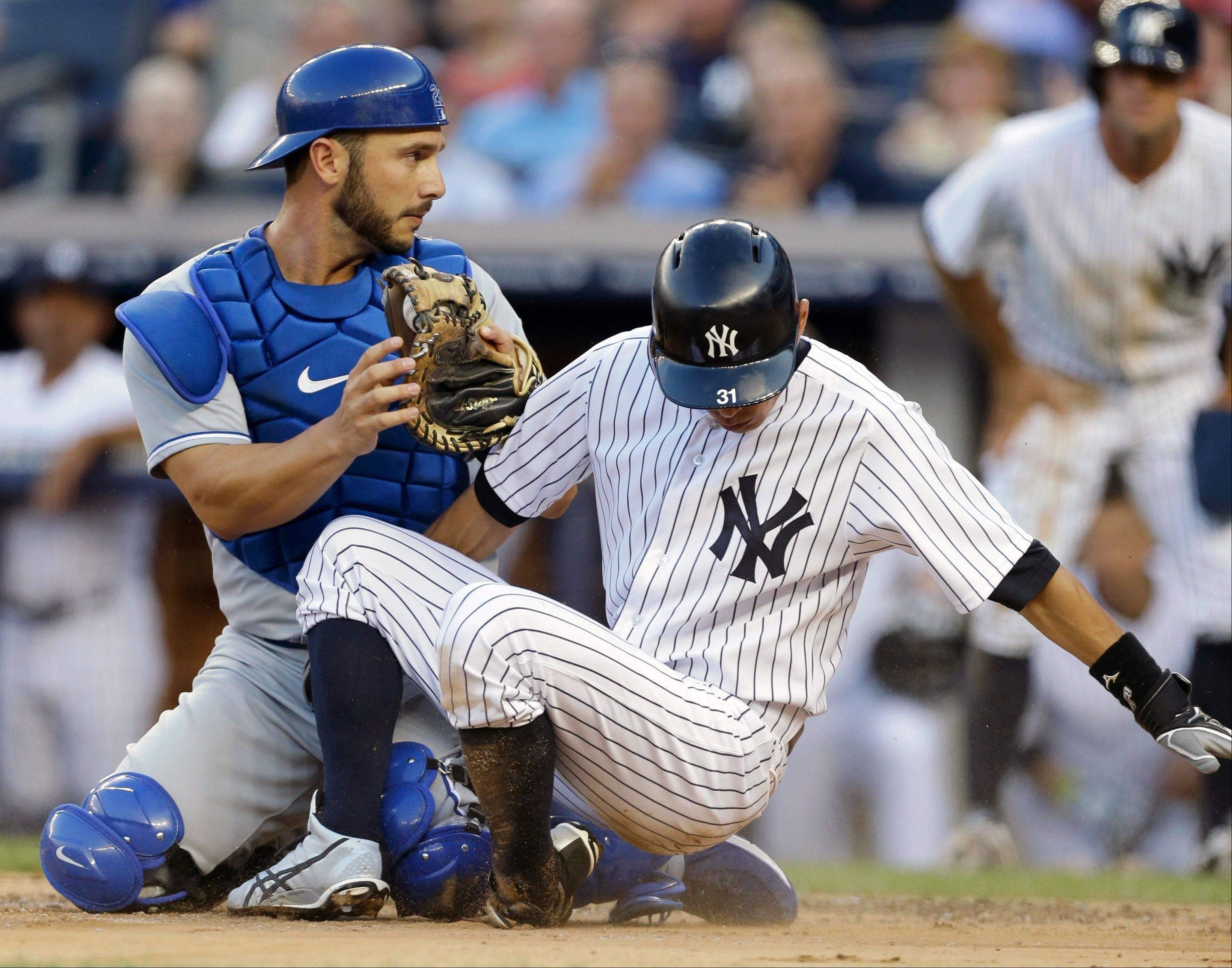 In a cash deal, the Cubs acquired catcher George Kottaras, a left-handed hitter, from the Kansas City Royals on Tuesday.