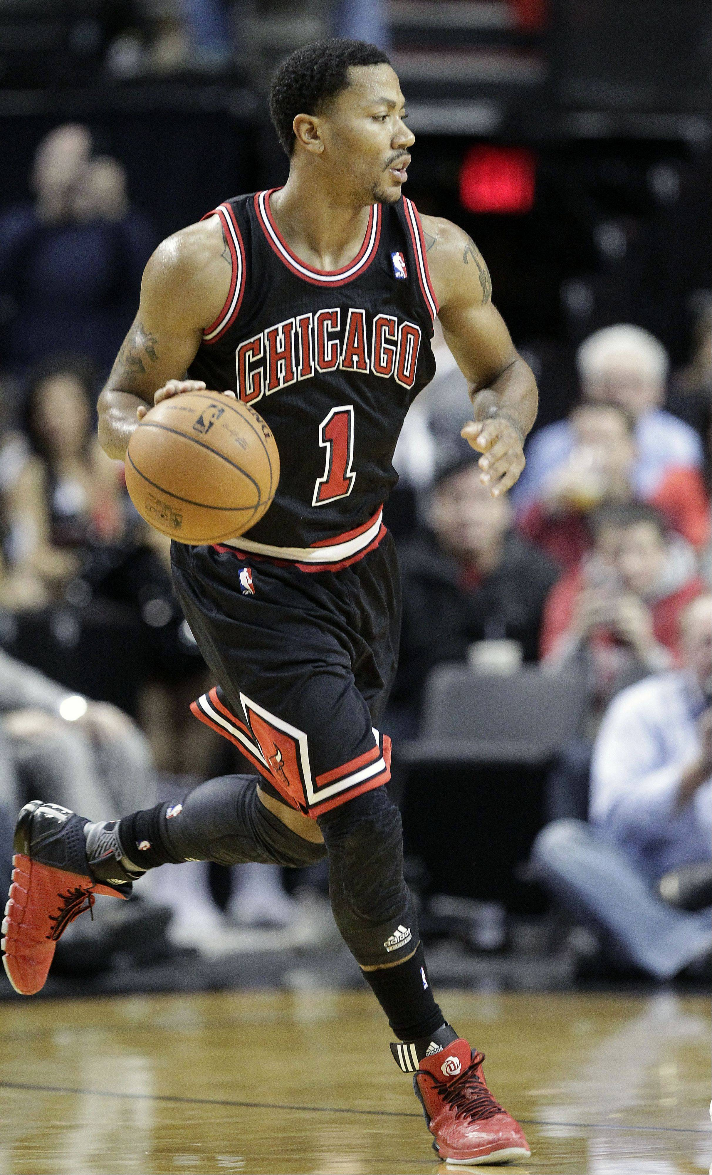Bulls guard Derrick Rose, shown here during the second half of Friday's game against the Portland Trail Blazers, is out for the season. Rose had surgery to repair a torn medial meniscus in his right knee.