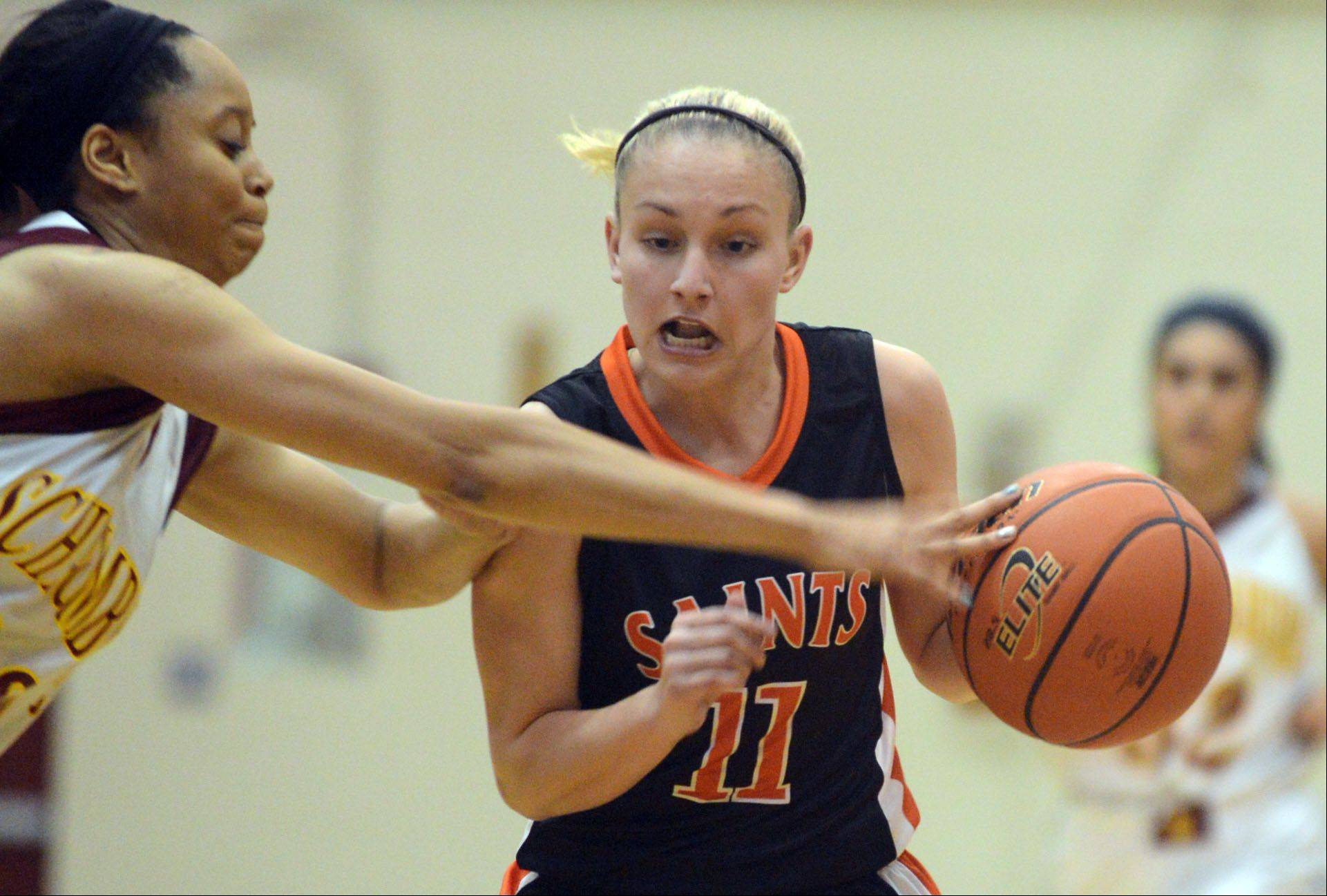 St. Charles East�s Katelyn Claussner, right, tries to get past Schaumburg�s Jada Blackwell Monday�s basketball game in Schaumburg.