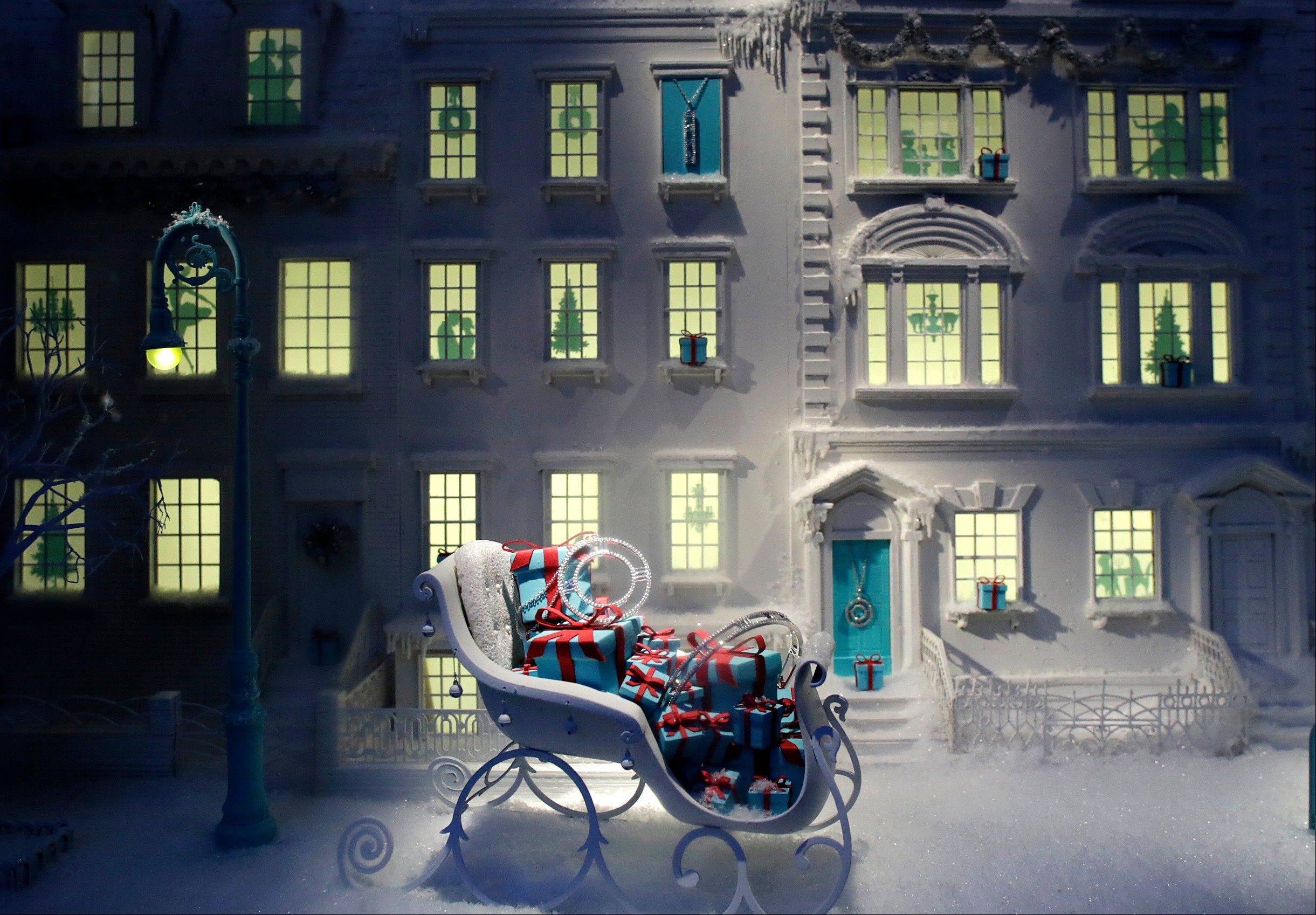 A sleigh filled with gift-wrapped jewelry boxes is displayed in a holiday window at Tiffany & Co. in New York. Reimagining every major holiday covered in a slick coating of ice, re-creating cozy Christmas-morning scenes and paying homage to a local legend can be an annual labor of love.