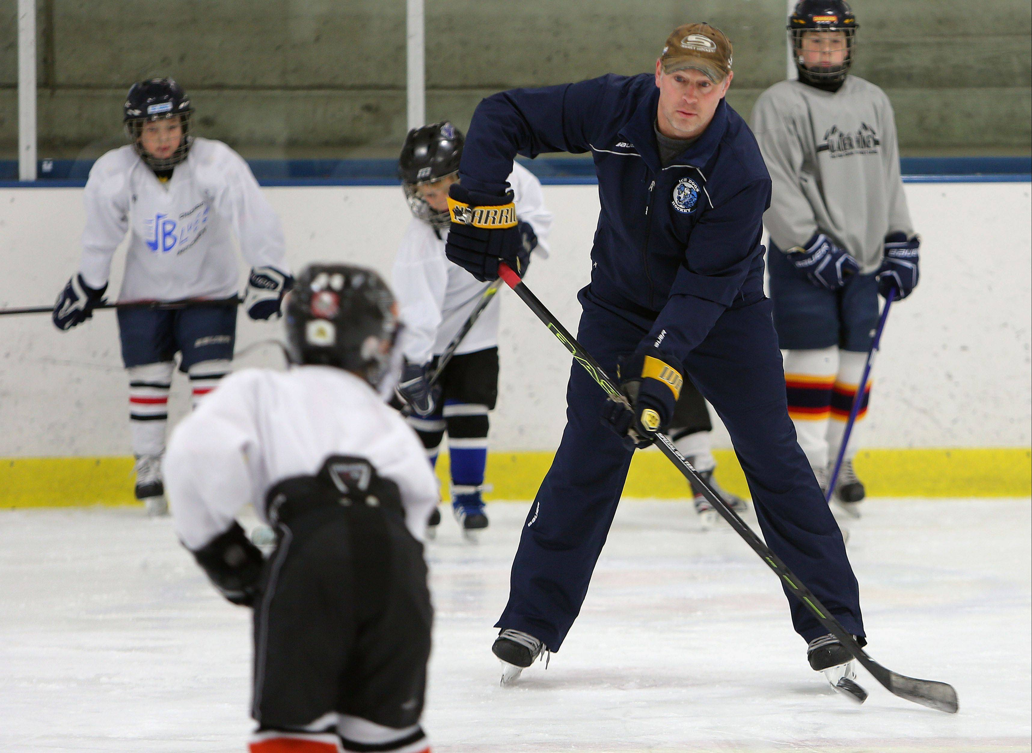 Former Chicago Blackhawks player Steve Dubinsky takes kids through drills during his hockey clinic Wednesday at Glacier Ice Arena in Vernon Hills.