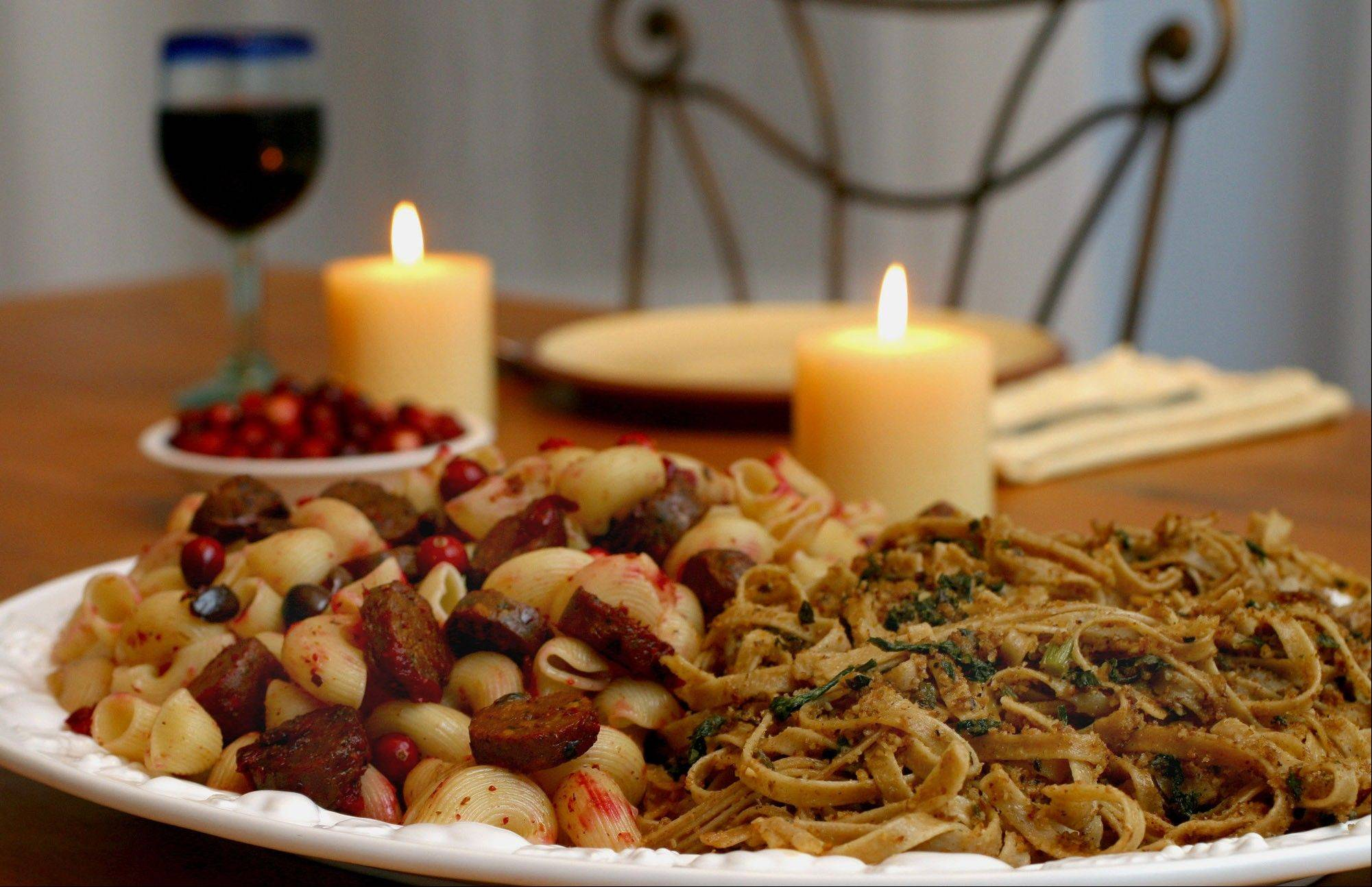 This Nov. 1, 2003, file photo, shows ziti with cranberries and Italian soy sausage, left, and Good Friday pasta, in Concord, N.H. In homes across the country on Thanksgiving Day, tables will be set to accommodate everyone from vegans and vegetarians to those trying to eat like a caveman. Increasingly complicated Thanksgiving feasts reflect the growing ranks of Americans who are paying closer attention to the food they put in their bodies.