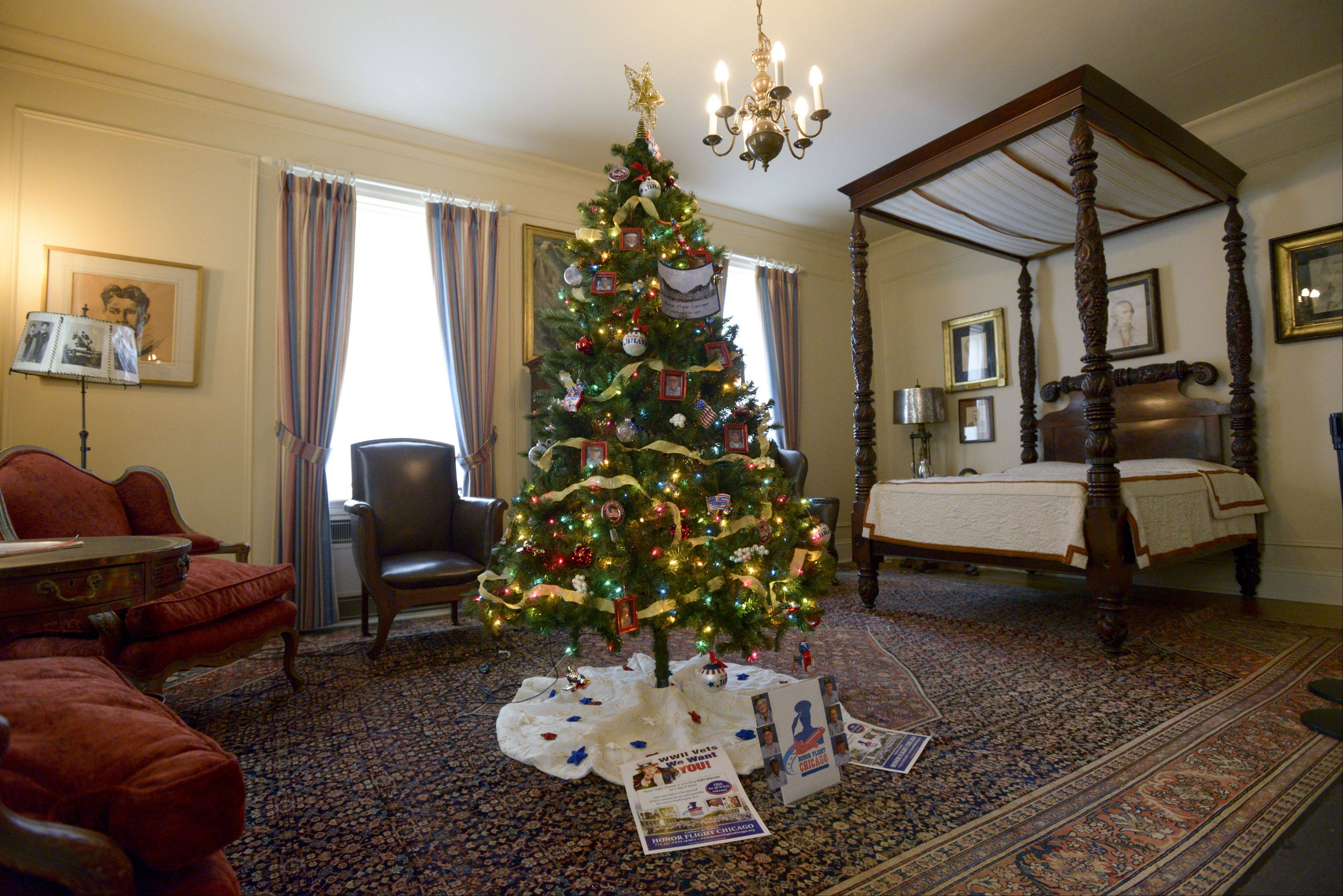 A Christmas tree decorated by volunteers from Honor Flight Chicago, exhibited in Col. Robert McCormick's bedroom, is one of seven such trees on display through the end of December at the McCormick Museum in Wheaton's Cantigny Park. All the themed trees were decorated by nonprofit groups.