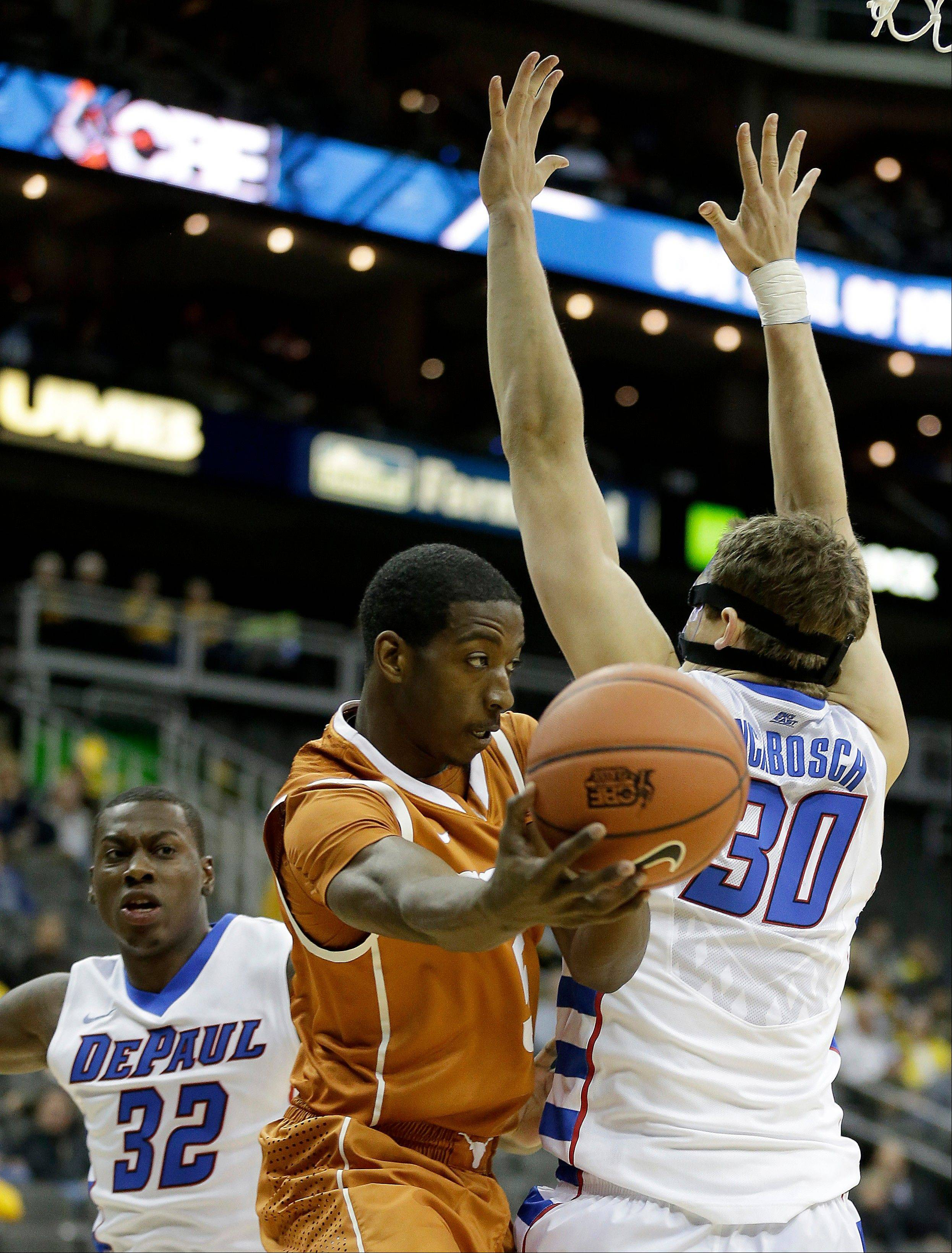 Texas' Damarcus Croaker, center, passes around DePaul's Peter Ryckbosch (30) during the first half of an NCAA college basketball game Tuesday, Nov. 26, 2013, in Kansas City, Mo.