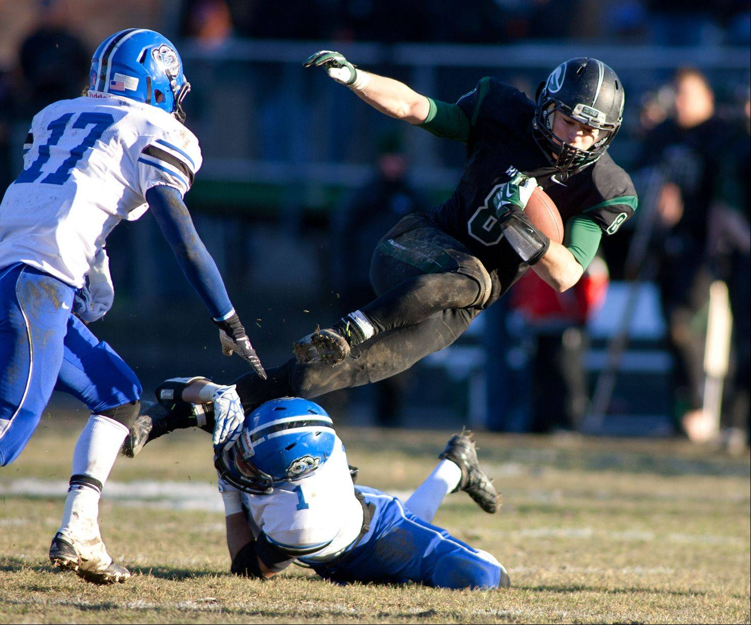 Glenbard West's Hayden Carlson (8) is upended by Lake Zurich's Jordan Juarez during the final minutes of Saturday's game.