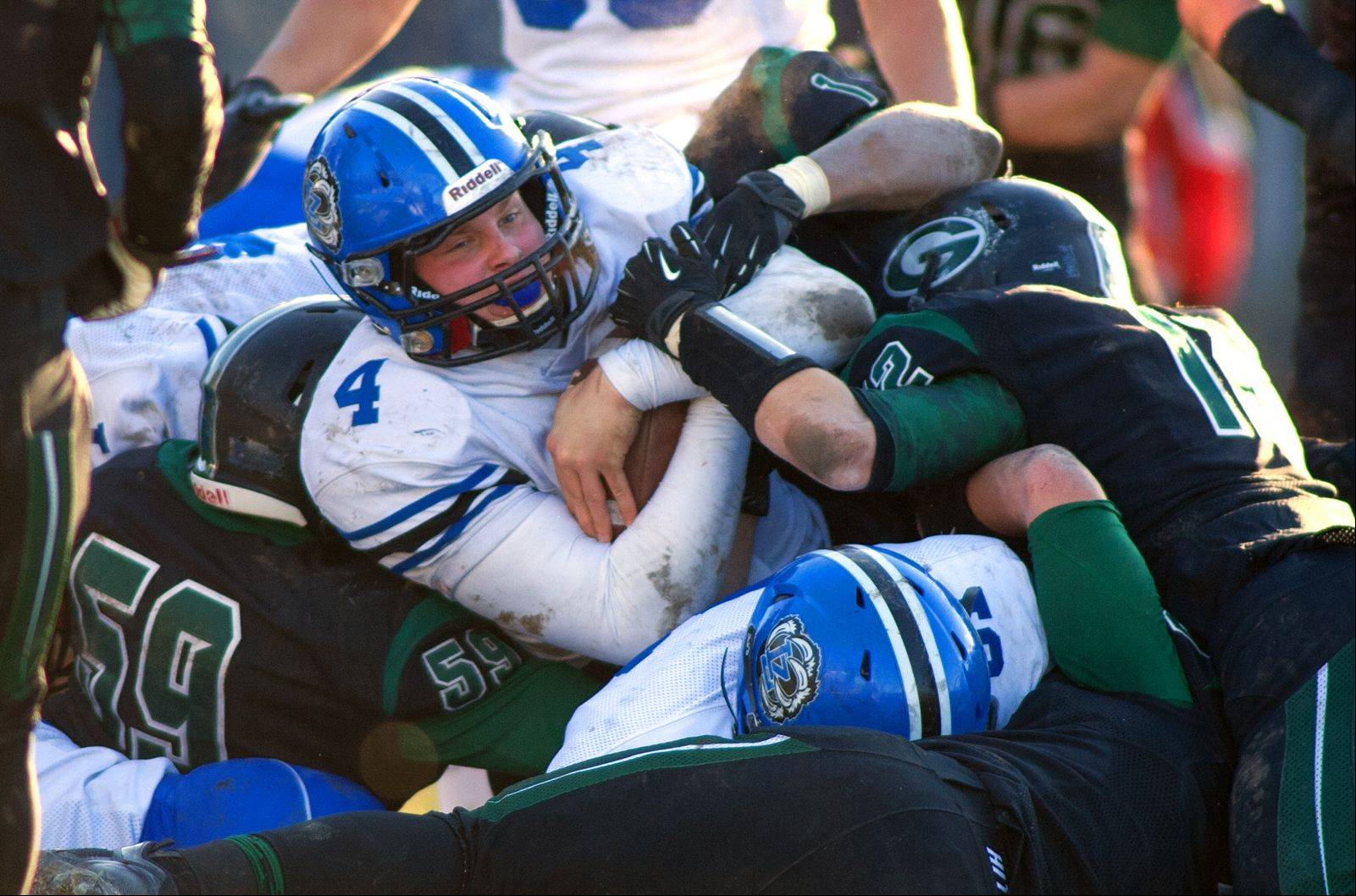 Lake Zurich quarterback Noah Allgood dives over the goal line for a touchdown Saturday against Glenbard West.