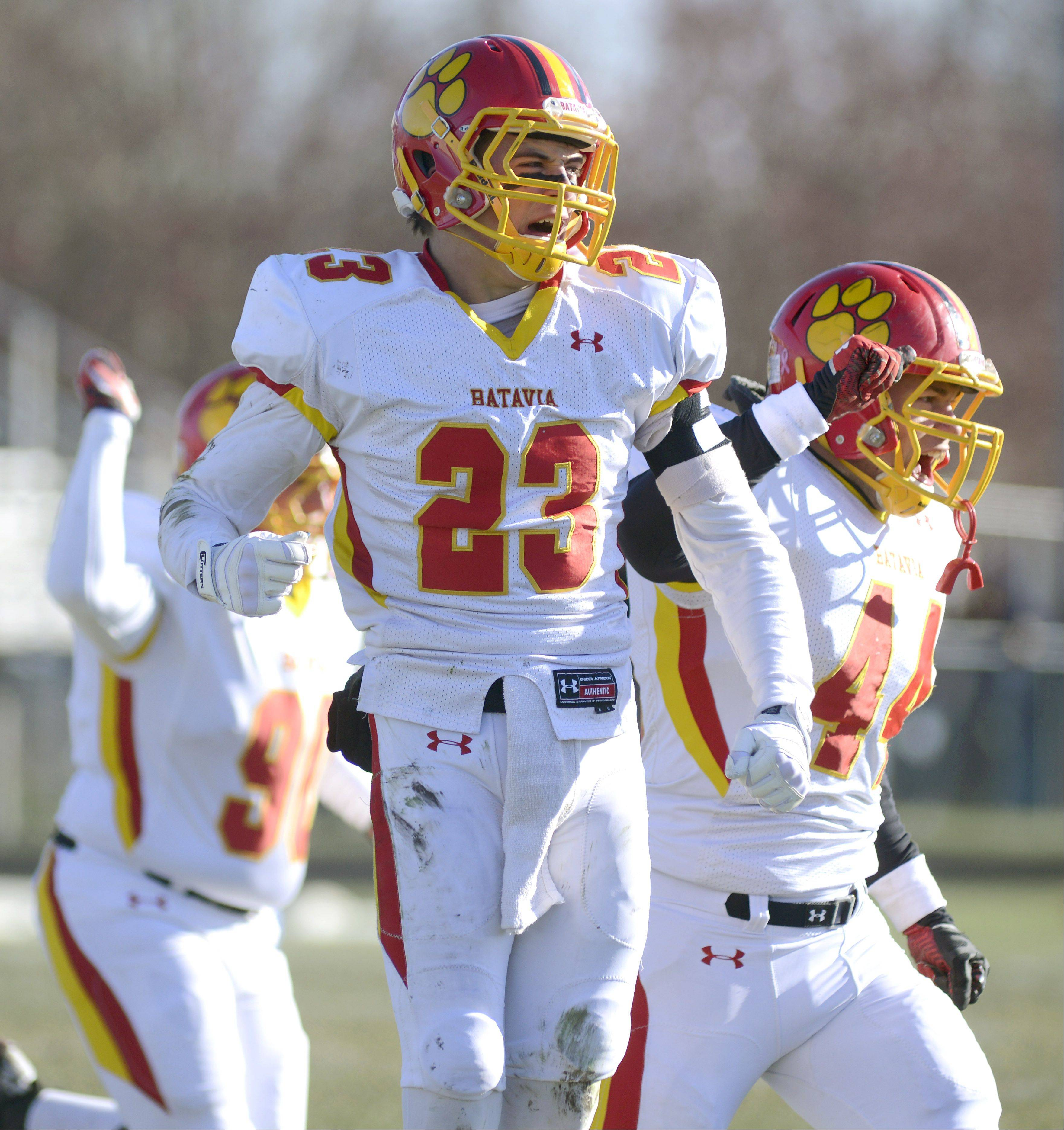 Batavia's Michael Moffatt (23) and Noah Frazier (44) celebrate a Rockford Boylan fumble recovered by the Bulldogs Saturday.