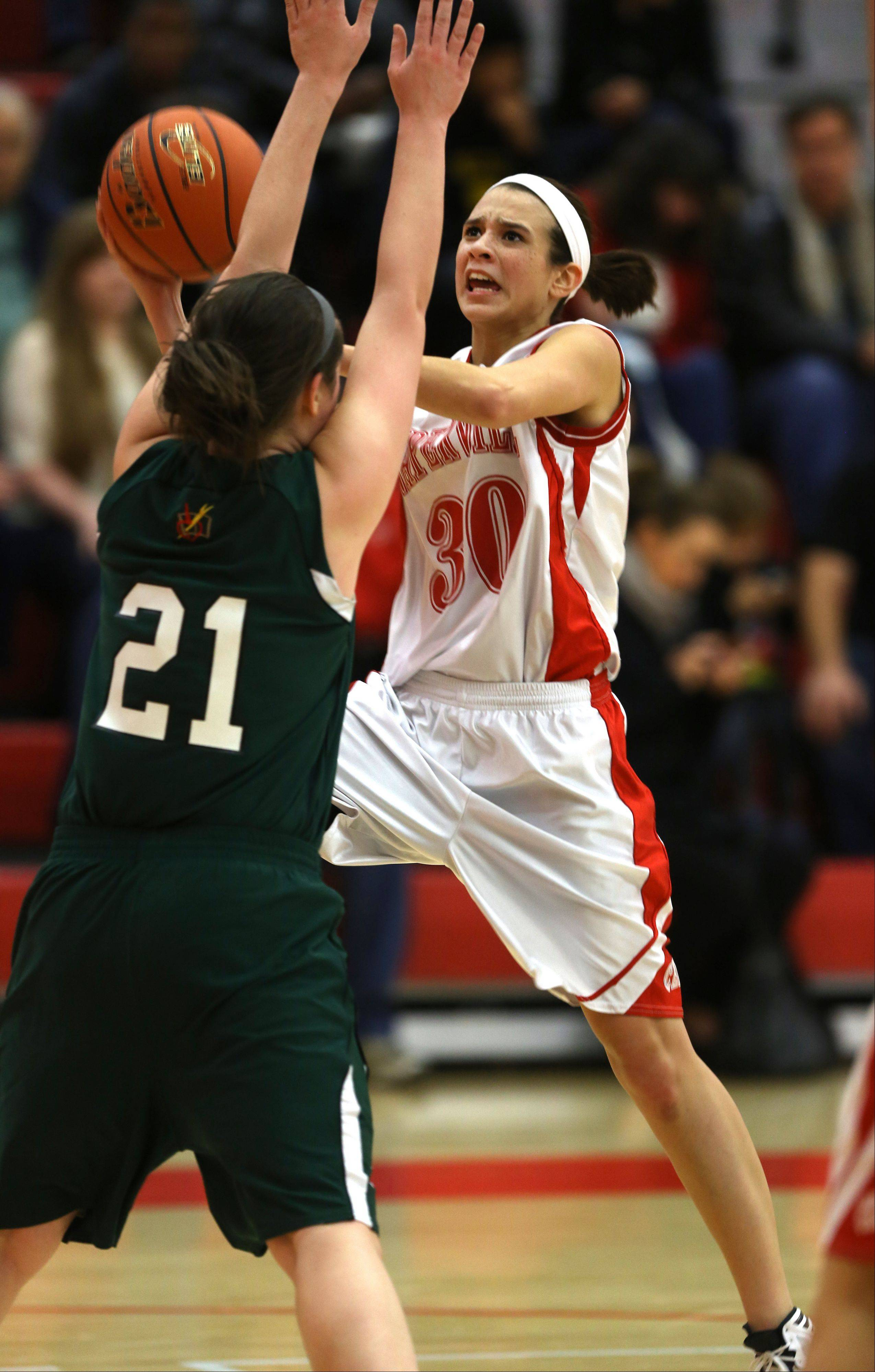 Naperville Central's Shannon Ryan drives the lane against Providence's Mary Fashingbauer (21), during the Tip-Off Tournament.