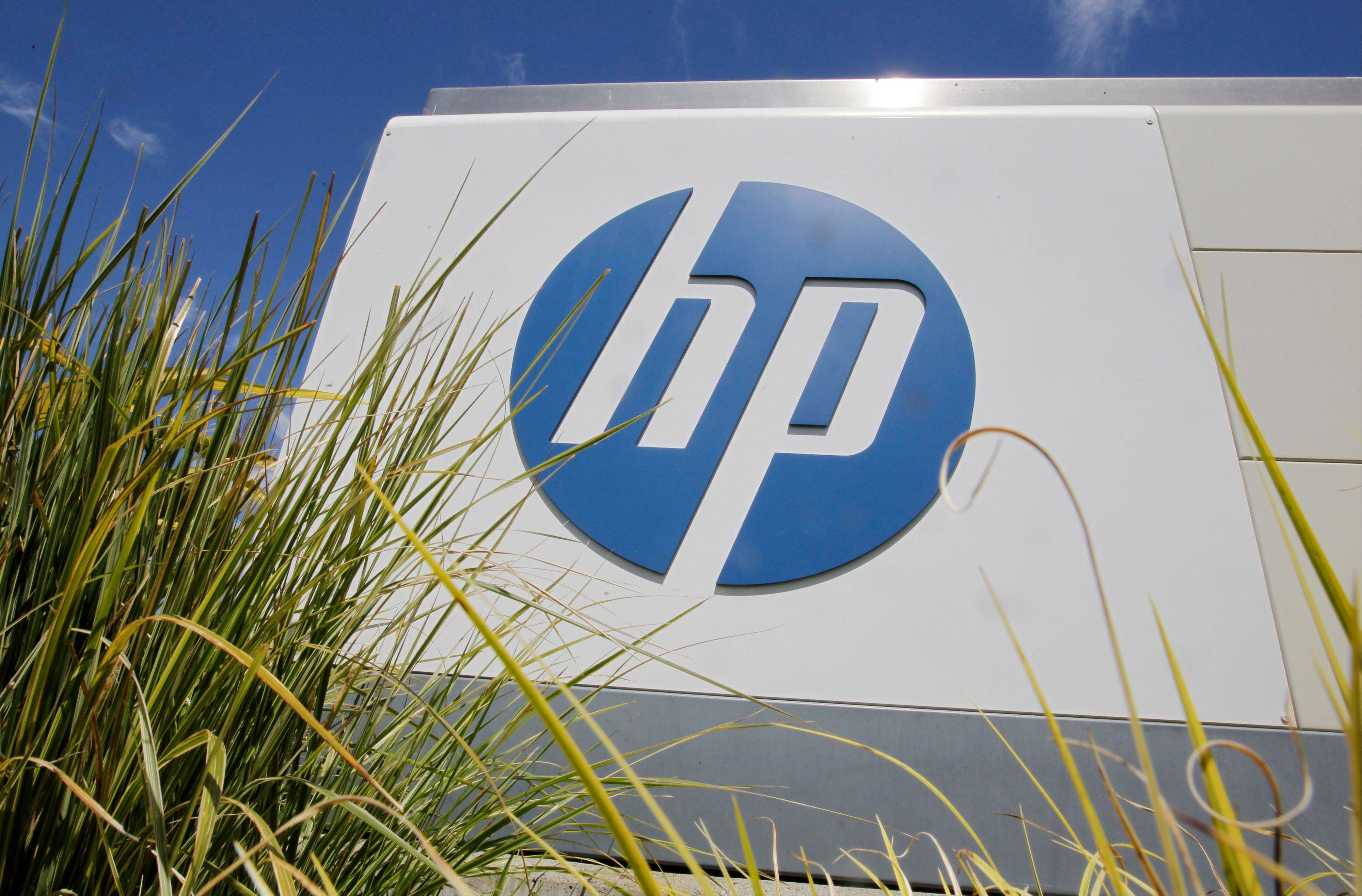 FILE - In this Aug. 21, 2012, file photo, the Hewlett-Packard Co. logo is seen outside the company's headquarters in Palo Alto, Calif. Hewlett-Packard Co. reports quarterly financial results after the market closes on Tuesday, Nov. 26, 2013. (AP Photo/Paul Sakuma, File)