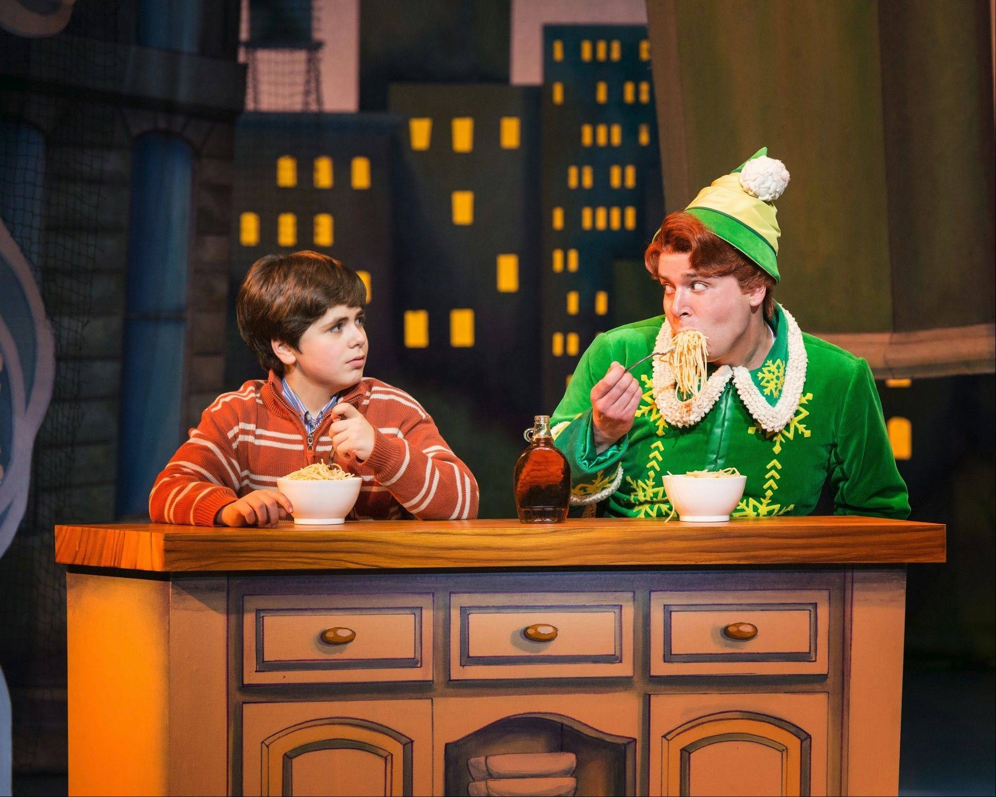 "Half-brothers Michael (Noah Marlowe) and Buddy (Will Blum) get to know each other in ""Elf The Musical,"" now playing at the Cadillac Palace Theatre through Sunday, Dec. 15."