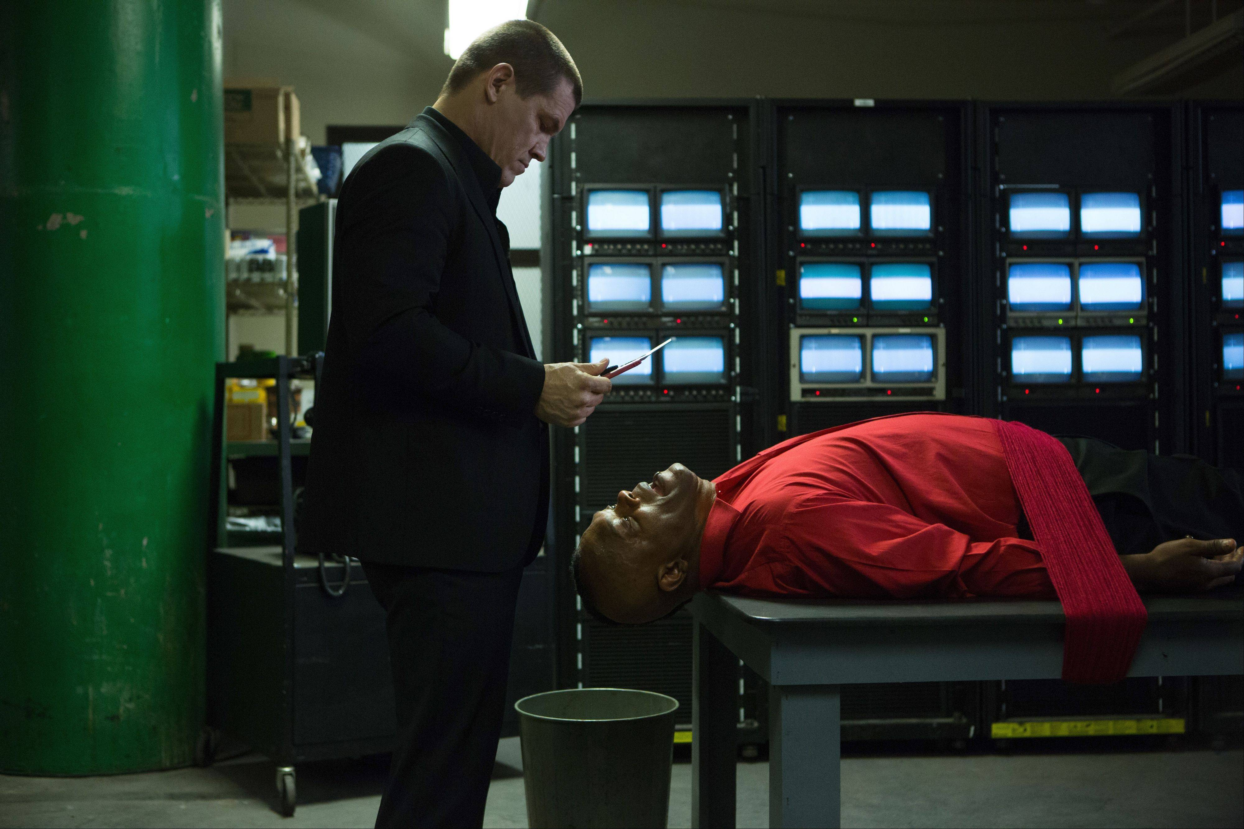 "Joe (Josh Brolin) prepares to conduct some severe interrogation techniques on a prison bureaucrat (Samuel L. Jackson) in Spike Lee's remake of ""Oldboy."""