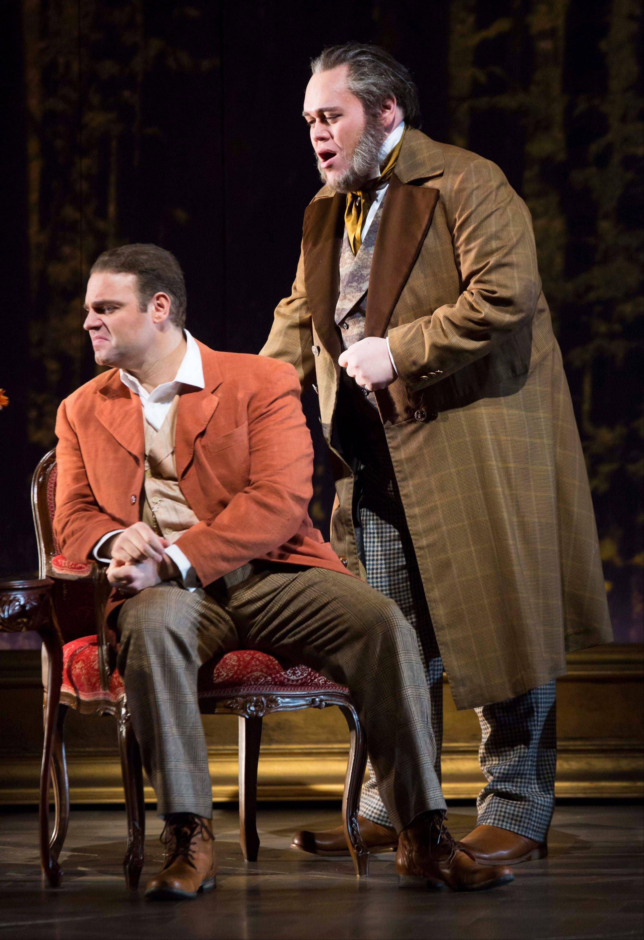 "Quinn Kelsey, right, plays Germont with Joseph Calleja as his son Alfredo, during the second act of the dress rehearsal of Lyric's production of ""La Traviata"" in Chicago. The opera runs through Dec. 20."