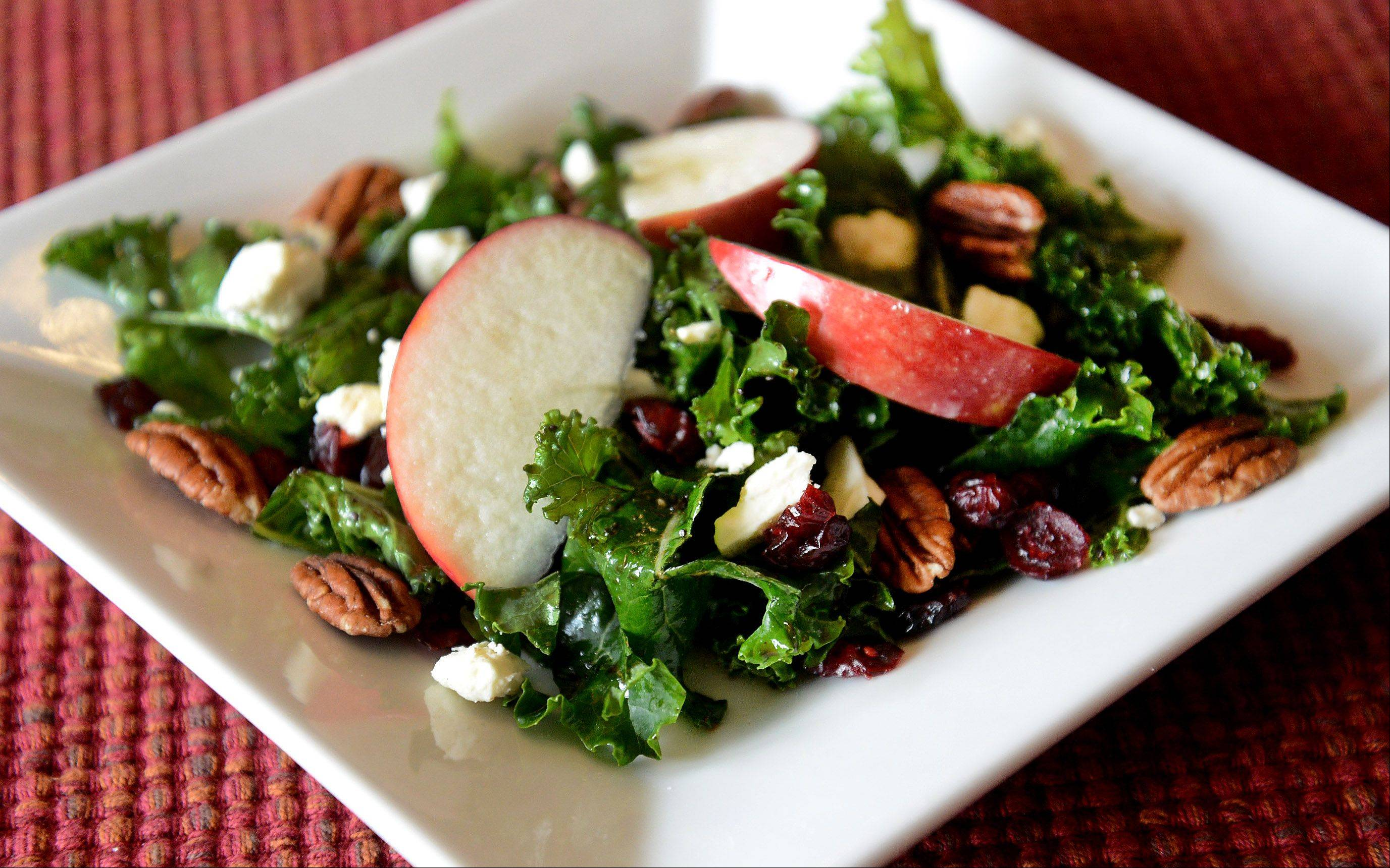 Joe Moninski�s apple- and cranberry-topped kale salad is festive for holiday entertaining.