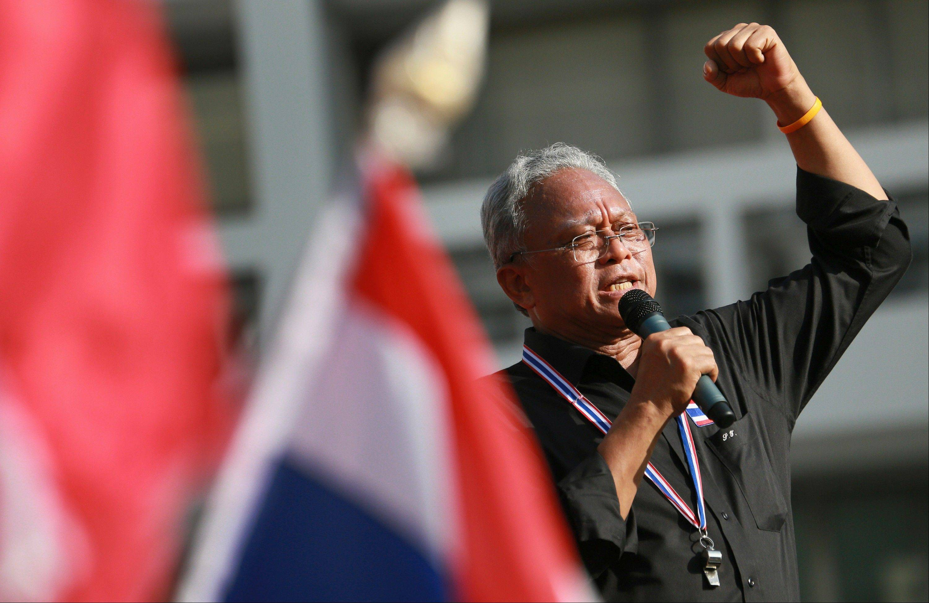 Suthep Thaugsuban, a former deputy premier leading the protest movement, talks to anti-government protesters outside the Government complex in Bangkok, Thailand, Wednesday, Nov. 27, 2013.