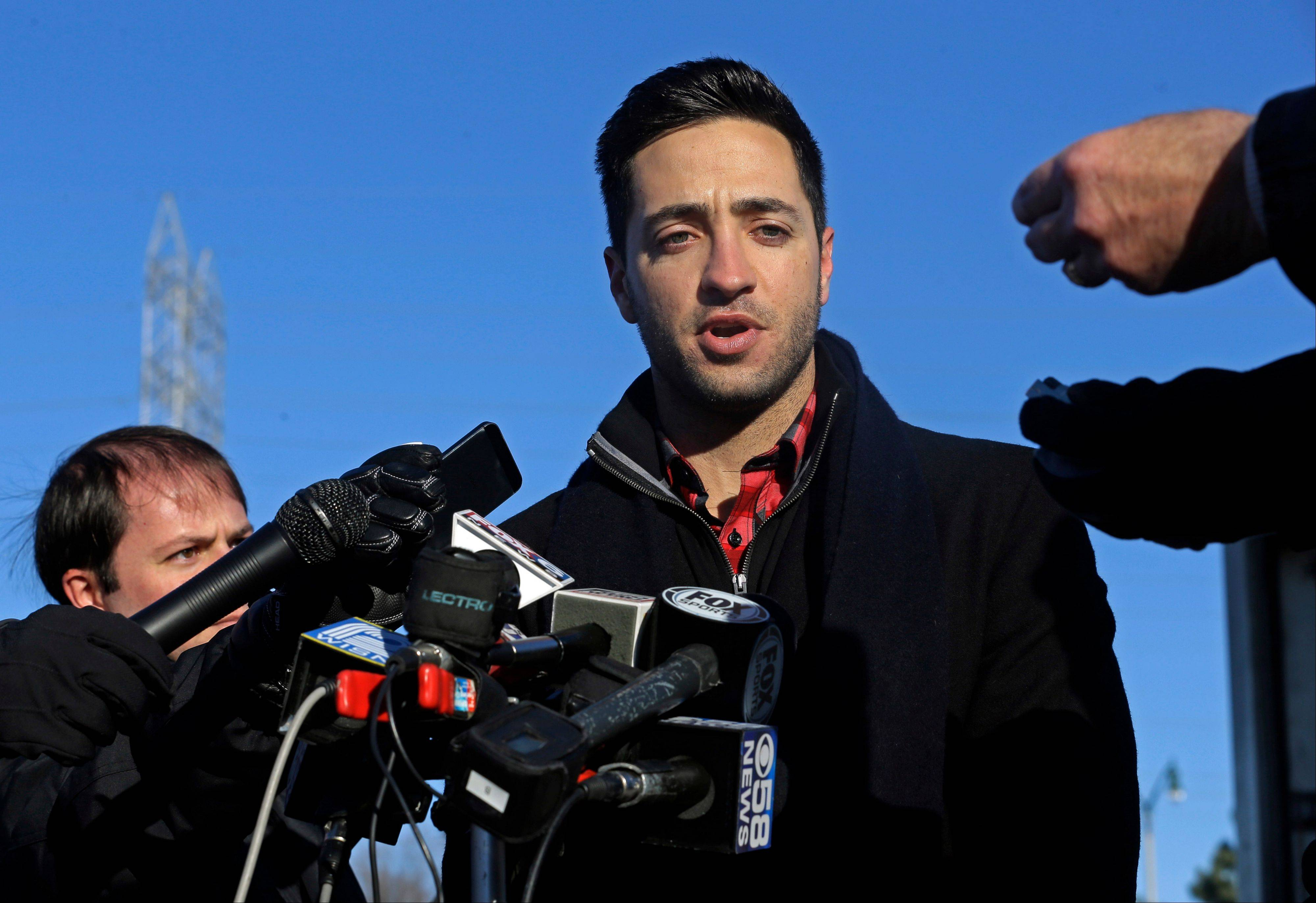 Milwaukee Brewers outfielder Ryan Braun talks about his baseball suspension outside Miller Park Wednesday in Milwaukee.
