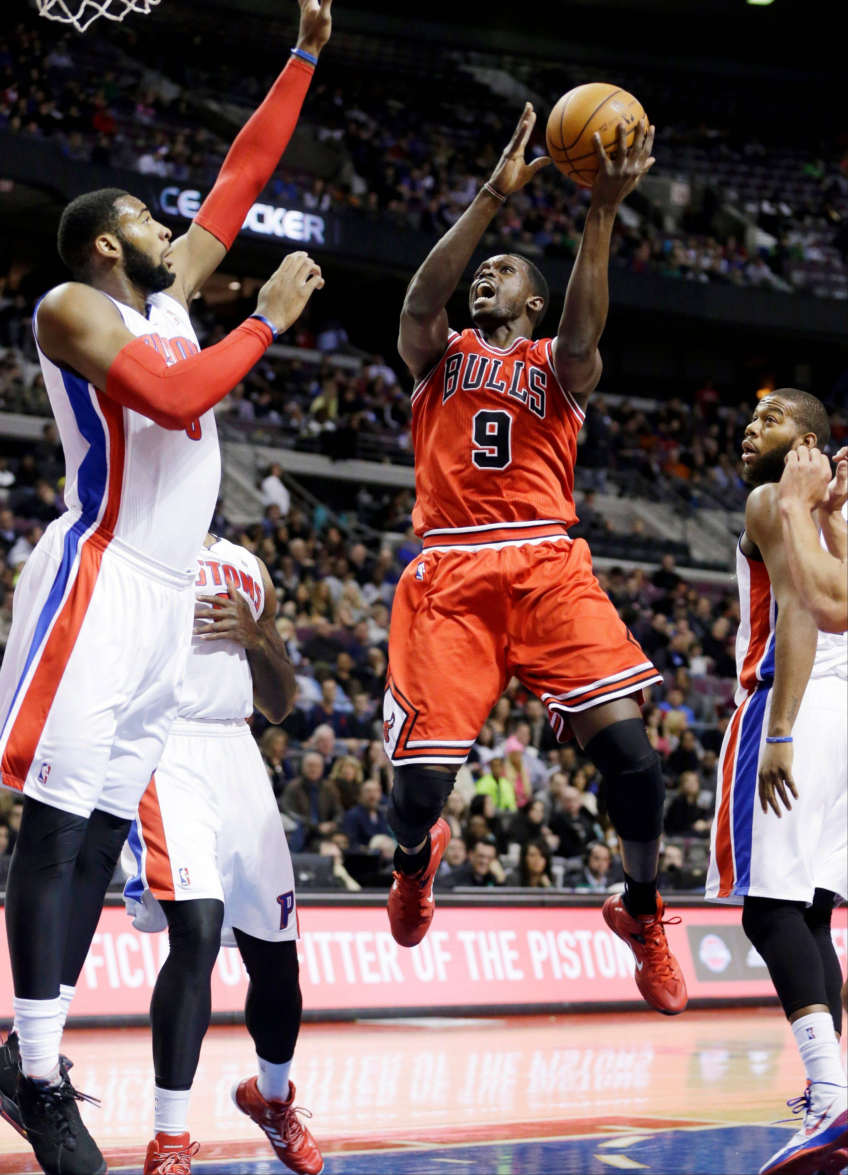 Bulls forward Luol Deng shoots over the defense of Detroit Pistons center Andre Drummond during the first quarter of an NBA basketball game in Auburn Hills, Mich., Wednesday, Nov. 27, 2013.