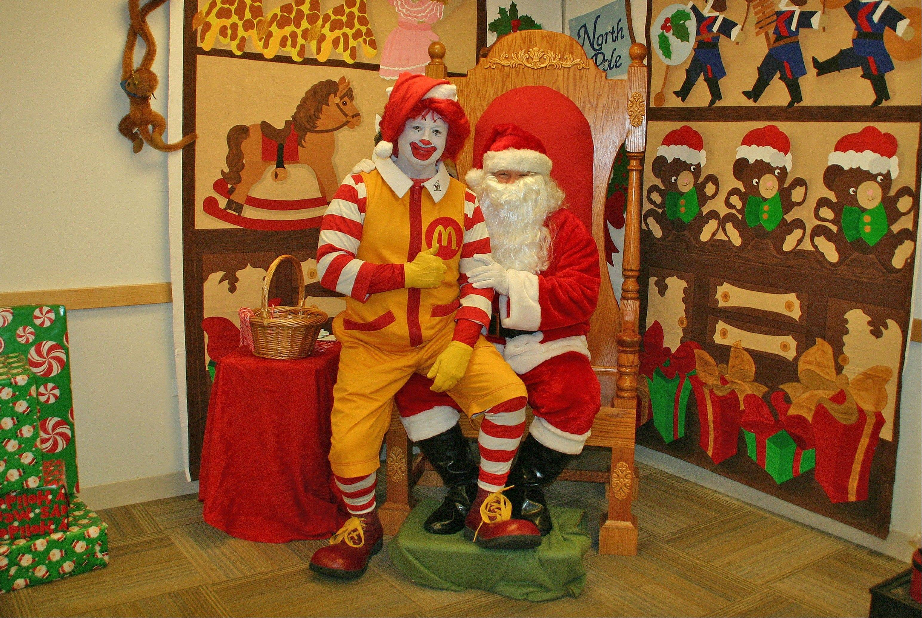 Ronald McDonald has his picture taken with Santa at the 2013 Winter Wonderland. Ronald will be at this year's fest on Sunday, Dec. 8.