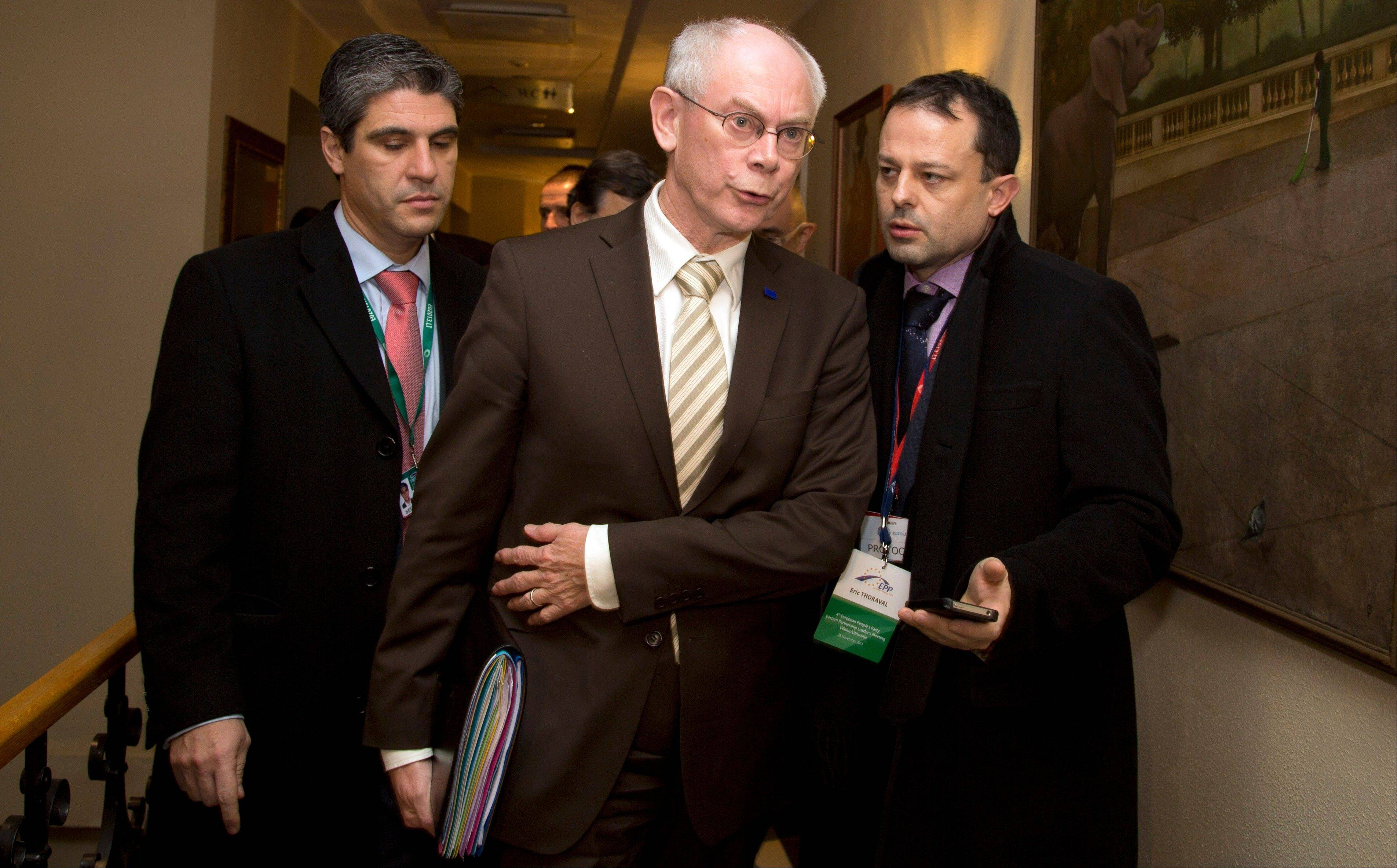 European Council President Herman Van Rompuy, center, leaves after a meeting of the EPP, ahead of an Eastern Partnership Summit in Vilnius on Thursday. European Union leaders sought Thursday to revive a stalled agreement with Ukraine.