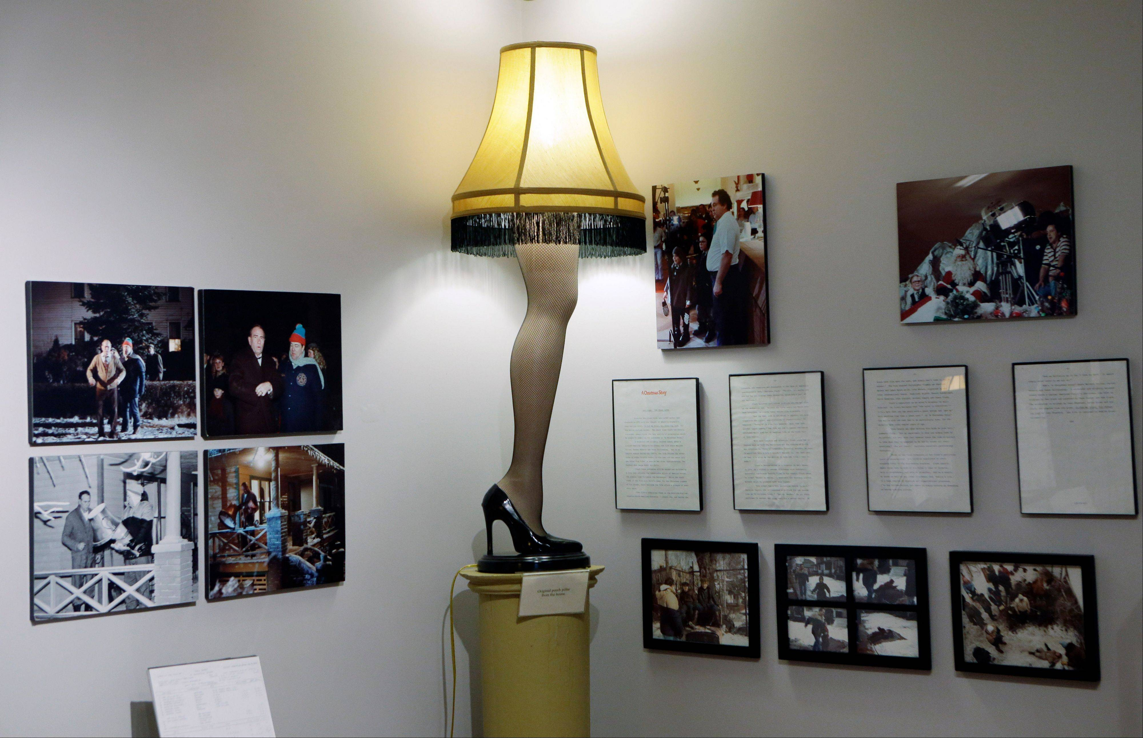 "A replica leg lamp is displayed with other memorabilia at the Christmas Story museum in Cleveland. The museum expects an influx of visitors on the 30th anniversary of ""A Christmas Story,"" the quirky holiday film turned classic in the city where Ralphie's house was restored on a bluff overlooking the steel mills. ("