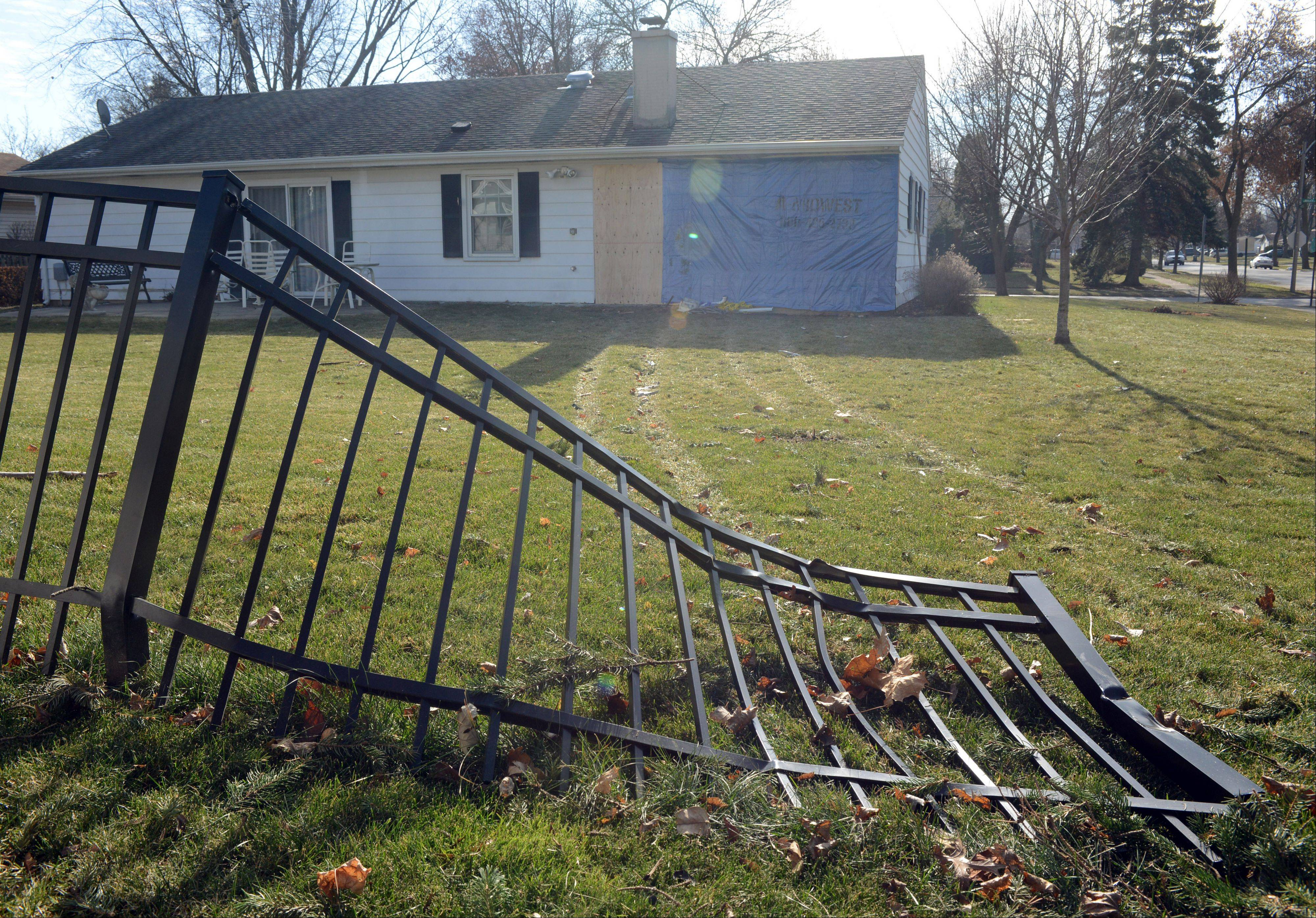 A broken fence remains after a car crashed into an Arlington Heights home Thanksgiving evening in the 900 block of West Maude Avenue.