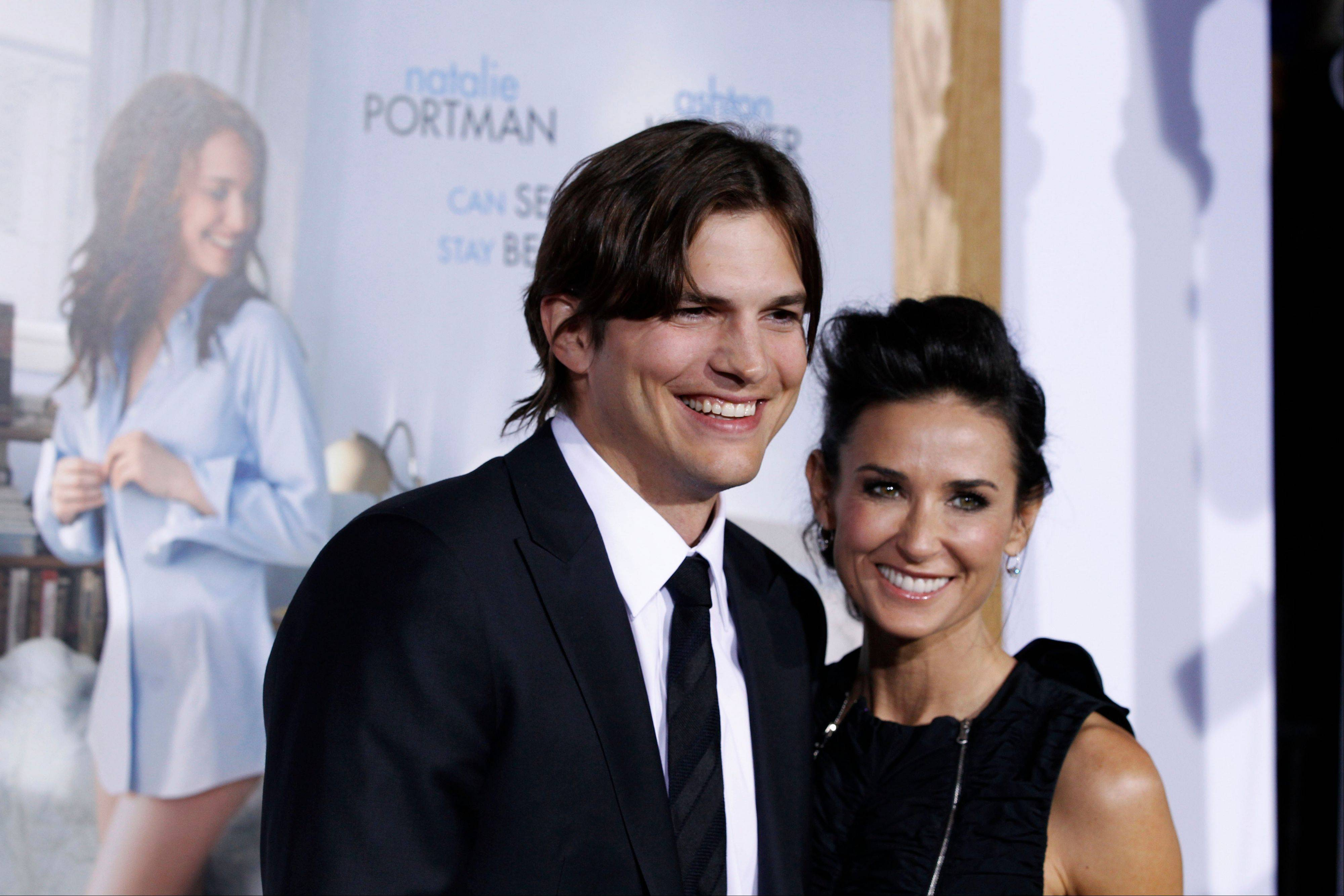 "Ashton Kutcher, left, and Demi Moore at the premiere for ""No Strings Attached"" in Los Angeles. A Los Angeles judge finalized Moore and Kutcher's divorce on Tuesday."