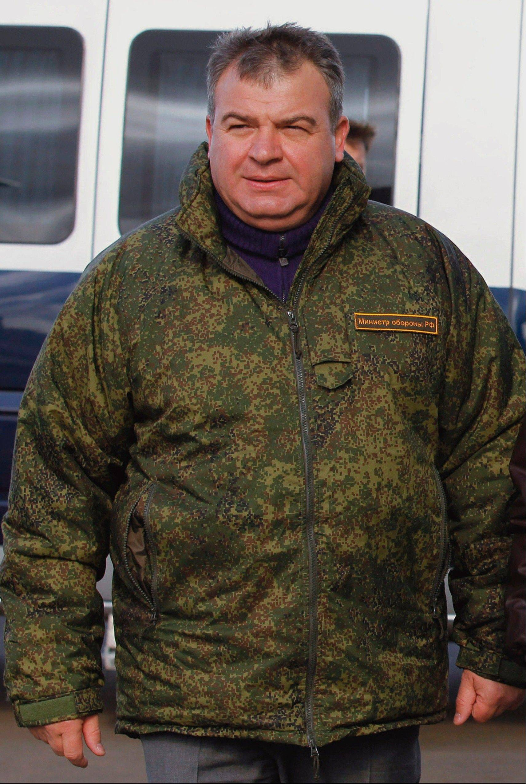 In this Tuesday, Sept. 27, 2011 file photo then Russian Defense Minister Anatoly Serdyukov walks during military maneuvers in the Chelyabinsk region of Russia. Russiaís main investigative agency filed charges against the former defense minister Thursday, Nov. 28, 2013, accusing him of using servicemen and government funds to build a road to a vacation home and do landscaping work on the property. If convicted, Serdyukov could face up to five years in prison.
