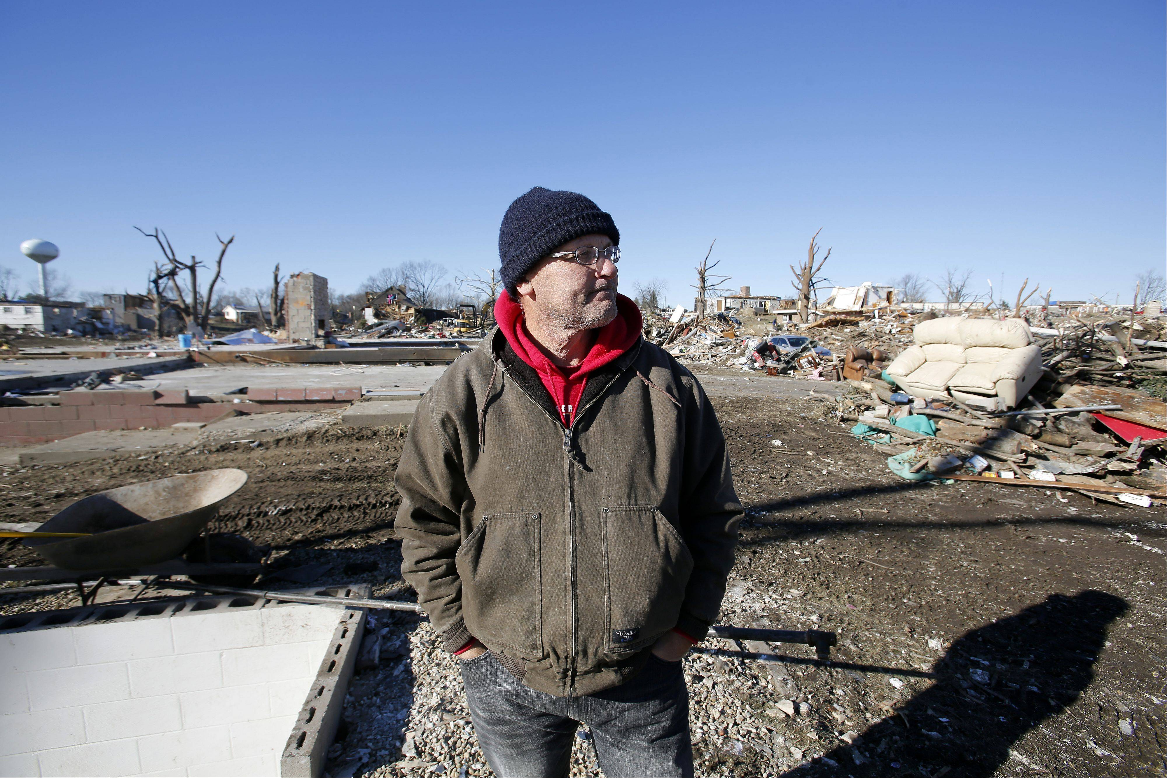 "Ben Alexander, who lost his home to the F4 tornado that struck downstate Washington Nov. 16, recalls where the family huddled together in the basement during the disaster. ""People always say that it sounds like a train, but it gets louder like a jet engine."" he said. The family thought they lost their cat Jasmine in the storm, but found her two days after cleanup efforts began. She also was hiding in the basement."
