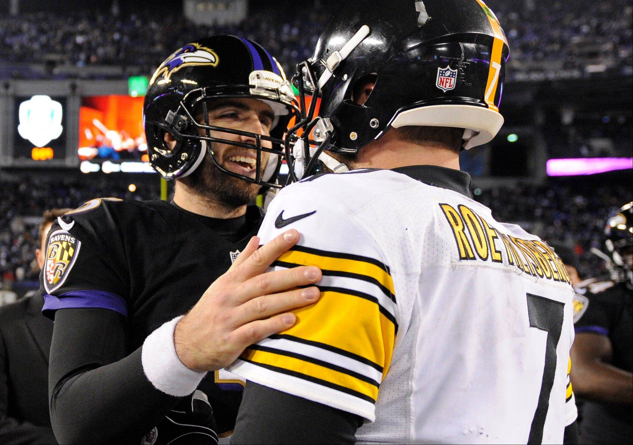 Baltimore Ravens quarterback Joe Flacco, left, chats with Pittsburgh Steelers quarterback Ben Roethlisberger after an NFL football game, Thursday, Nov. 28, 2013, in Baltimore. Baltimore won 22-20.