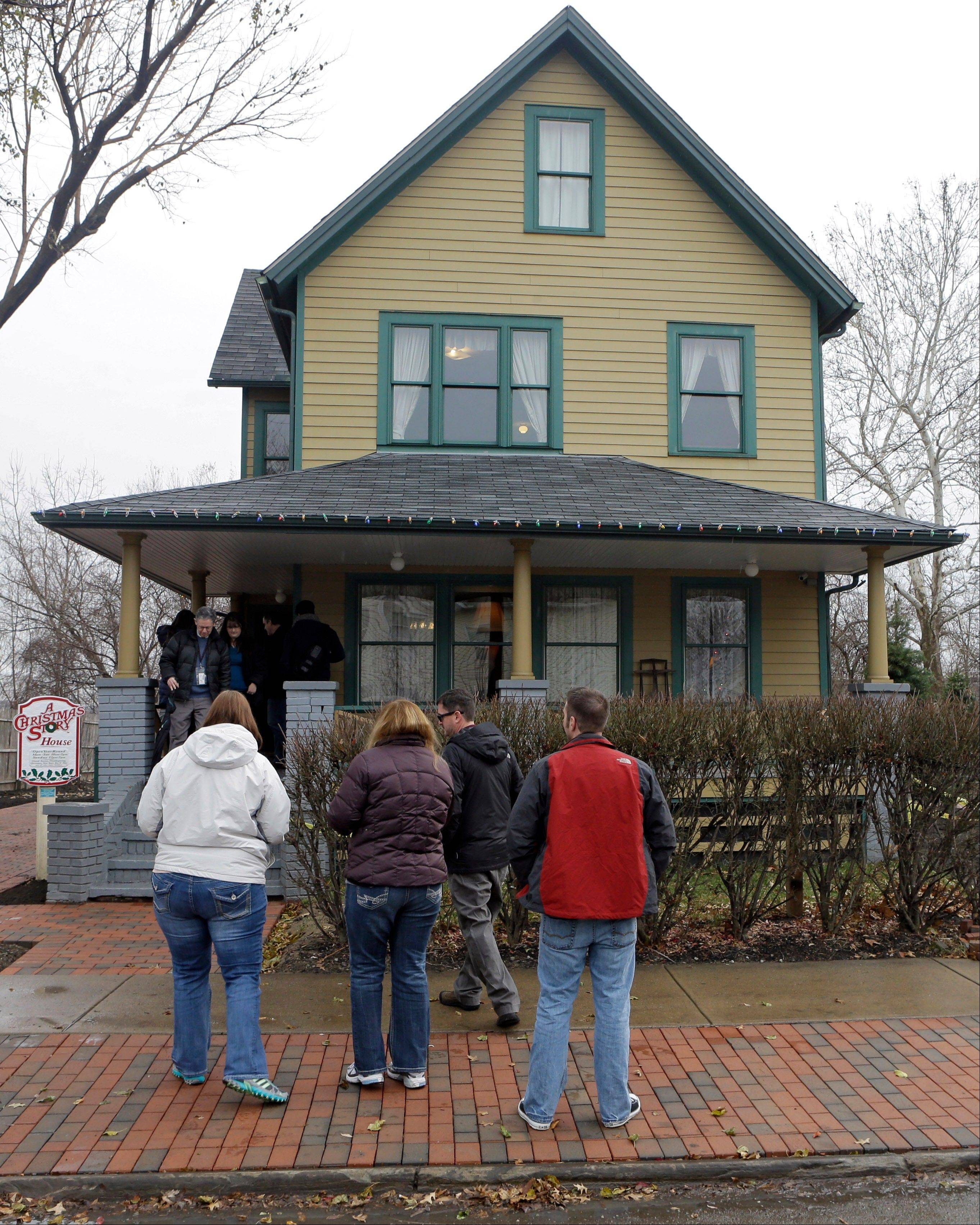 "visitors wait to tour the house in Cleveland where much of the 1983 movie ""A Christmas Story"" was filmed. The house and adjacent museum expect an influx of visitors on the 30th anniversary of the quirky holiday film turned classic in the city where Ralphie's house was restored on a bluff overlooking the steel mills."