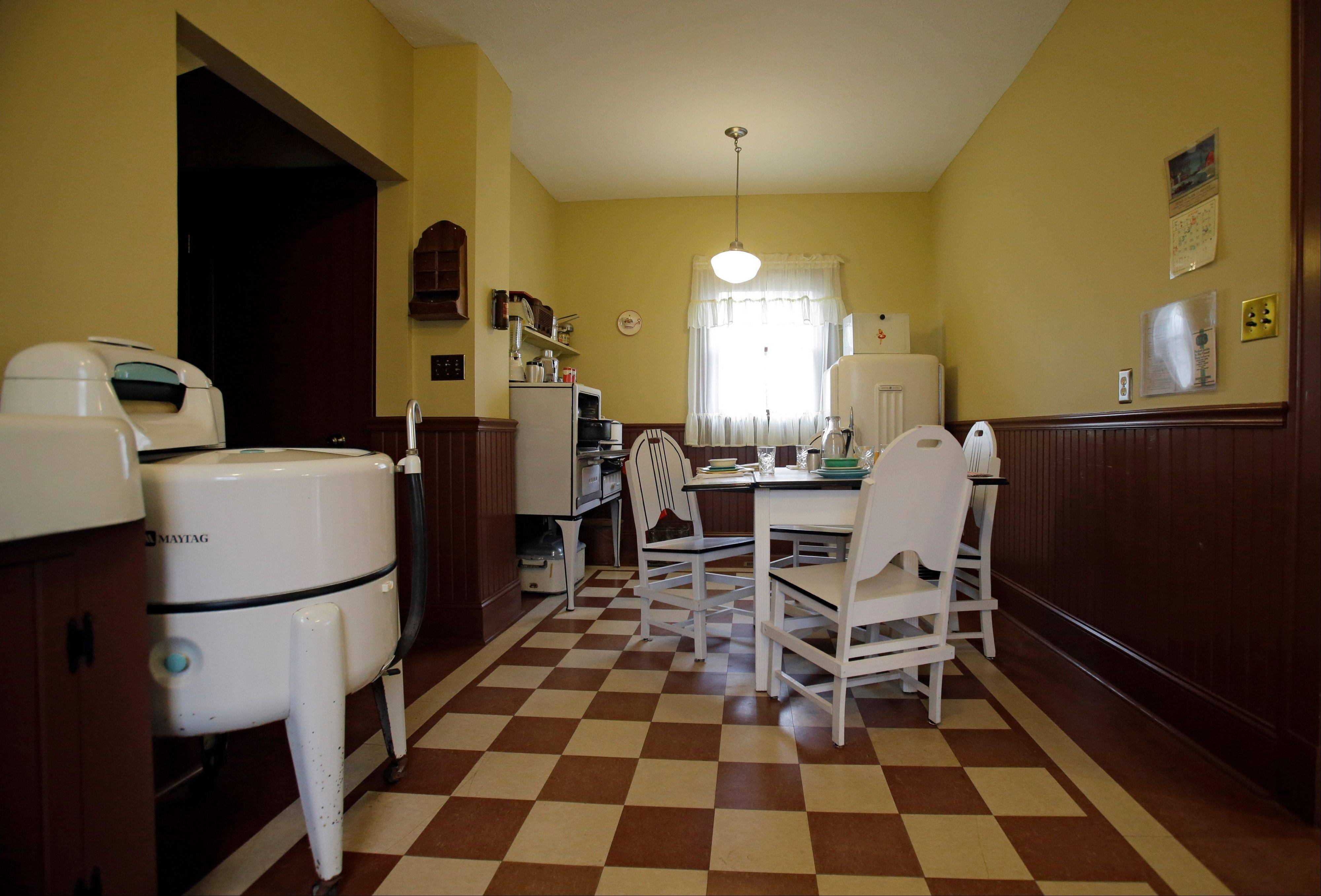 "In this Nov. 21, 2013, photo, the kitchen of the house in Cleveland where much of the 1983 movie ""A Christmas Story"" was filmed is restored to the 1940s look of the film. The 30th anniversary of the quirky holiday film is expected to boost visits to the home in the city's Tremont neighborhood."
