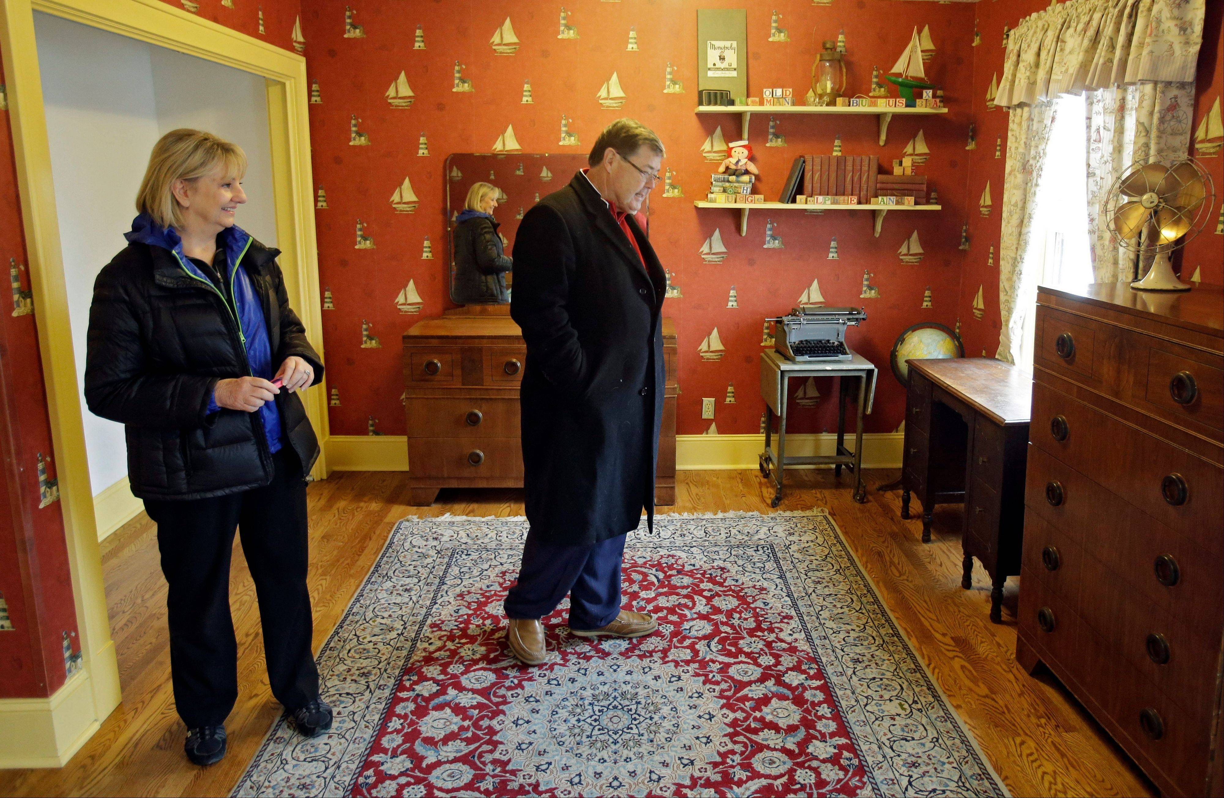 "In this Nov. 21, 2013, photo, Judy and Michael Paulson, from Plano, Texas, view Ralphie's room in the Cleveland house where the 1983 movie ""A Christmas Story"" was filmed. Interest in tours of the house, as well as the adjacent museum, is expected to increase during the 30th anniversary of the quirky holiday film."