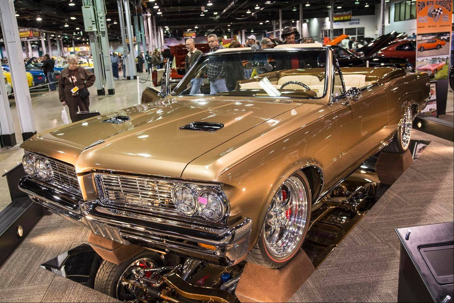 One of the most visually appealing things about John and Peggy Sieffert's 1964 Pontiac GTO is its shiny coat of Mocha and Cr�me Brulee paint.
