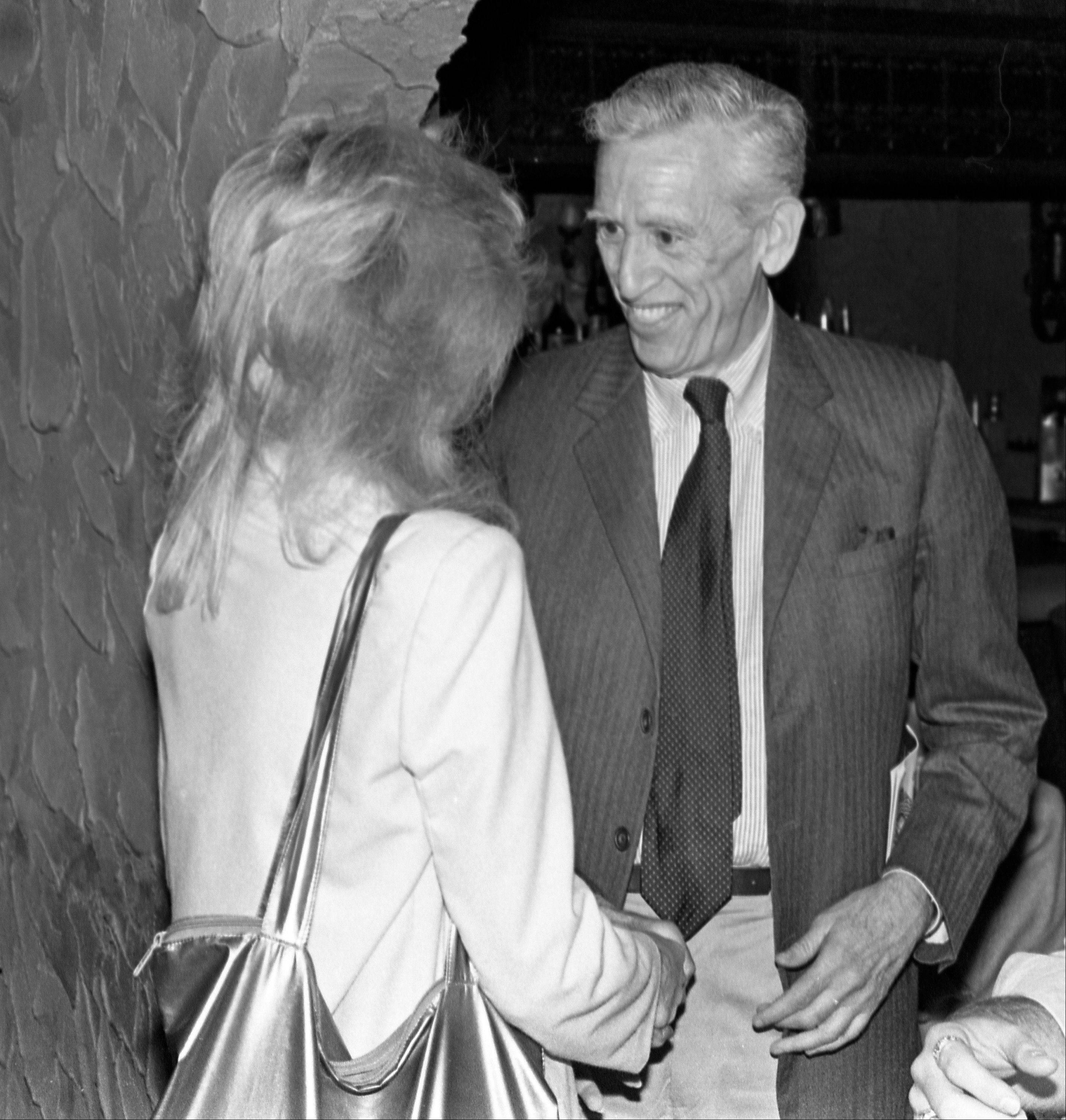 "J.D. Salinger, author of ""Catcher in the Rye,"" meets up with actress Elaine Joyce to see her performance in ""6 Rms Riv Vu"", at the Alhambra Dinner Theater on Beach Boulevard, in Jacksonville, Fla."