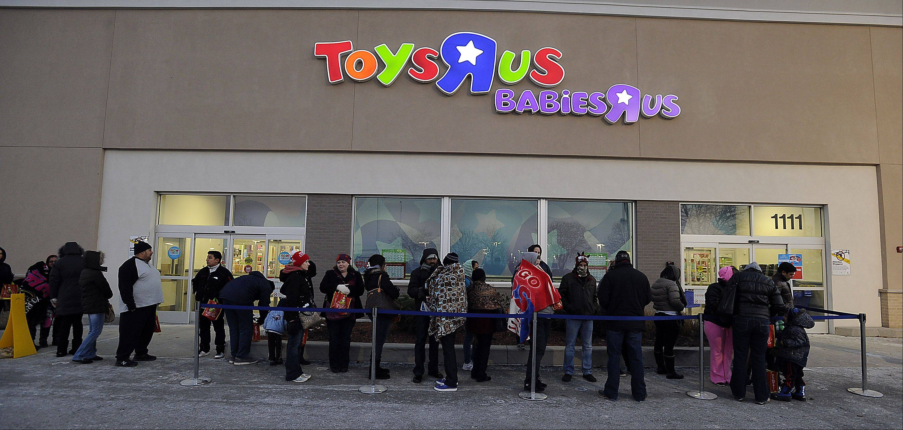 "Shoppers waited in line outside the Toys ""R"" Us in Schaumburg Thursday afternoon in hopes of getting doorbuster deals. The toy store was one of the earliest retailers to open -- at 5 p.m. -- on so-called ""Gray Thursday."""
