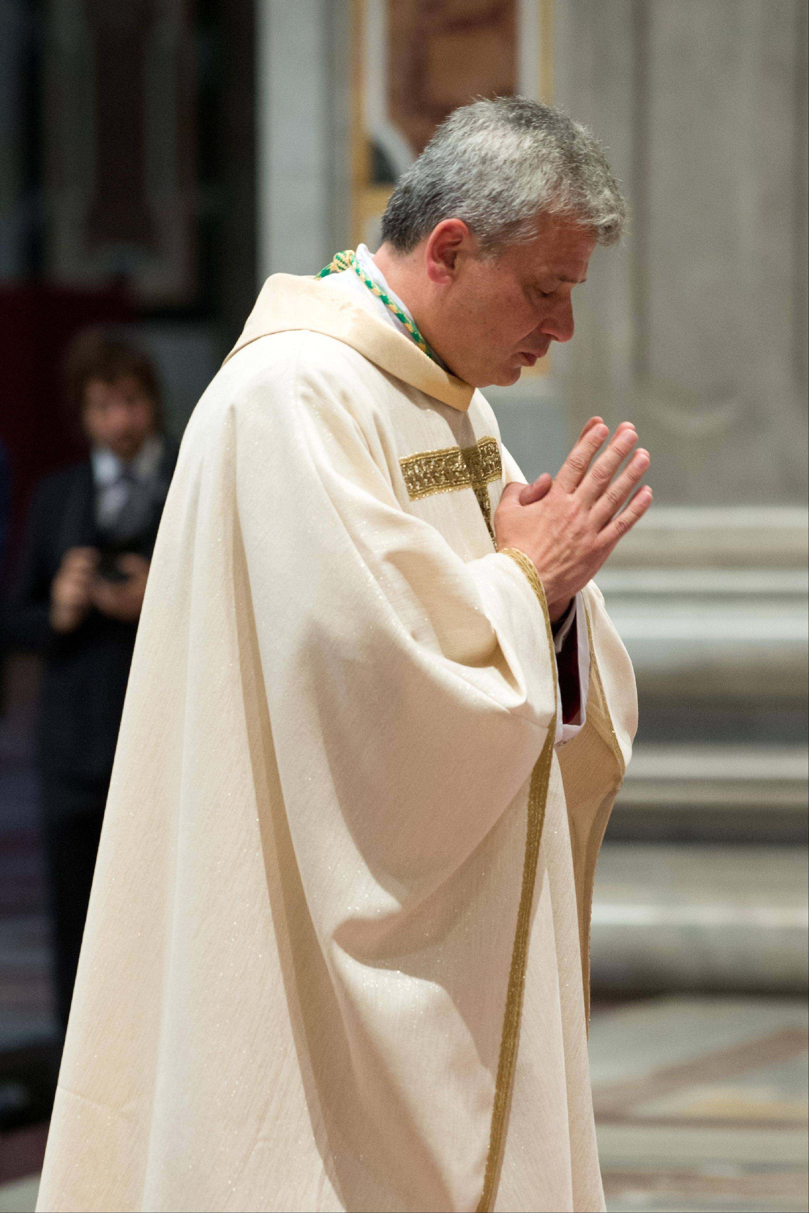Vatican Almoner, Archbishop Konrad Krajewski, attends the ceremony for his episcopal ordination.