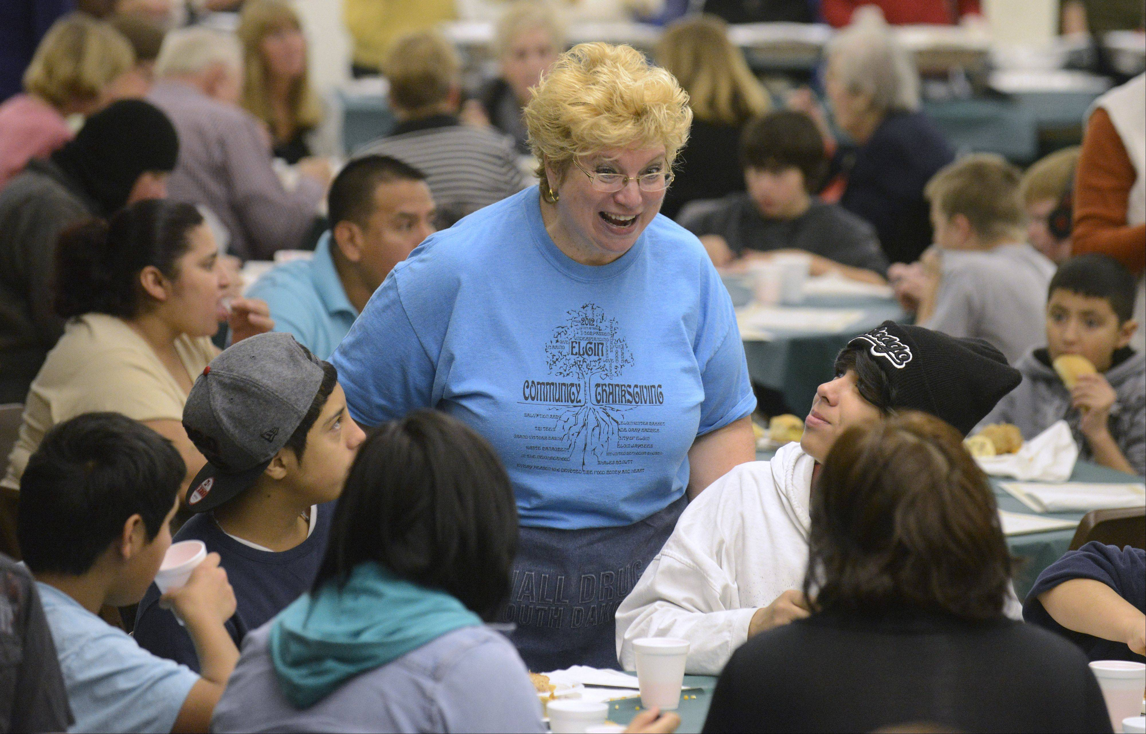 Diane Fraser of Elgin makes her way around tables chatting with diners at the Elgin Community Thanksgiving Dinner. This is her fourth year volunteering and she arrived two hours early to help prep for the 11 a.m. start.