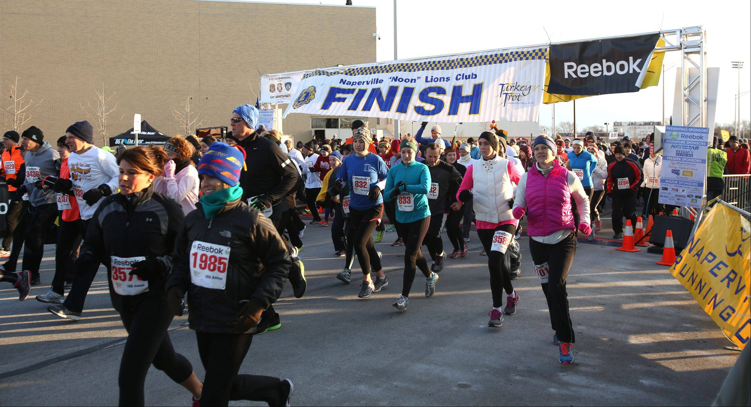 The starting line was crowded as 7,500 runners participated in the 16th annual Naperville Noon Lions 5K Turkey Trot Thursday morning.