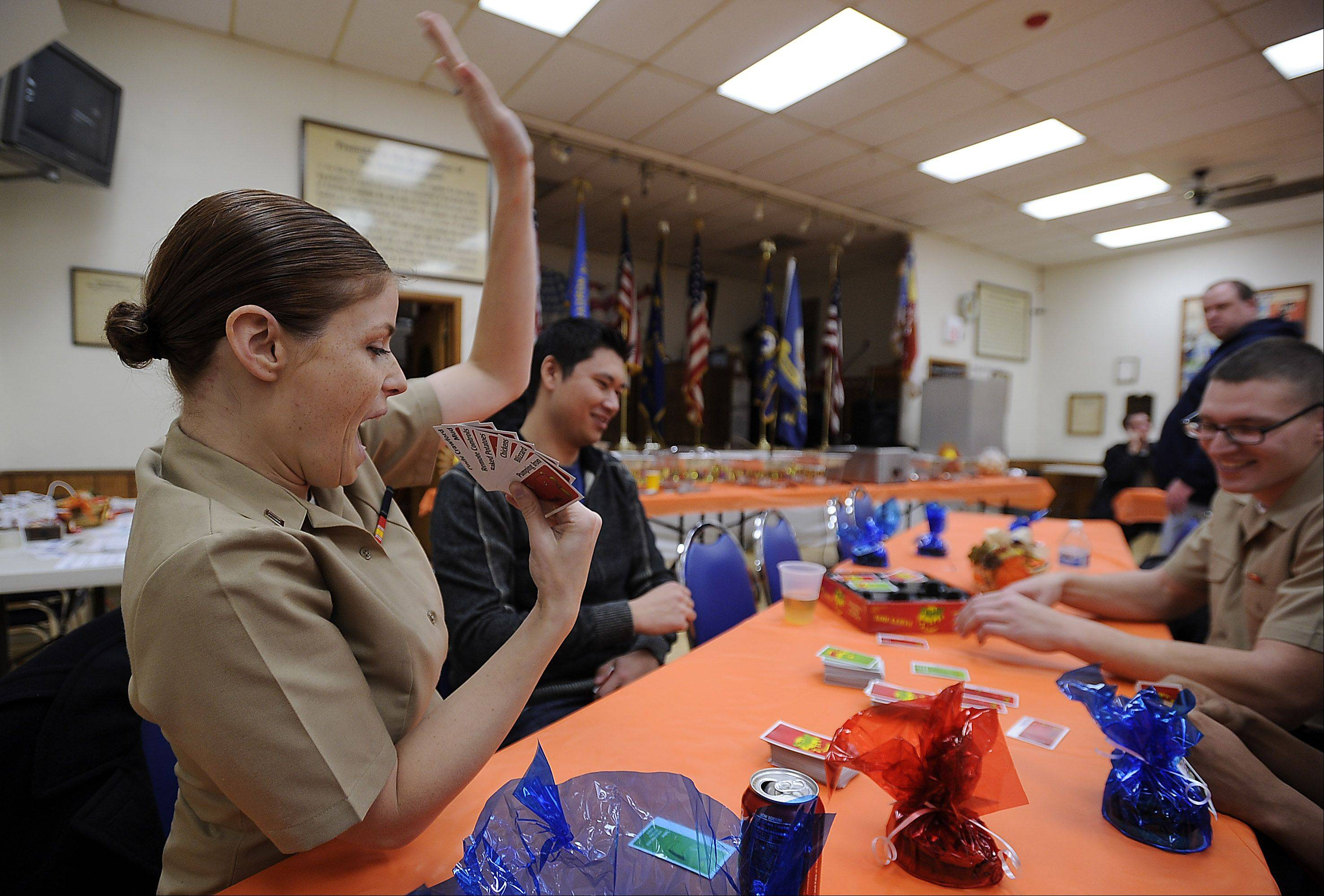 Kayla Turrubiate of Texas plays cards before Thanksgiving dinner at the American Legion Post 690 in Palatine Thursday.