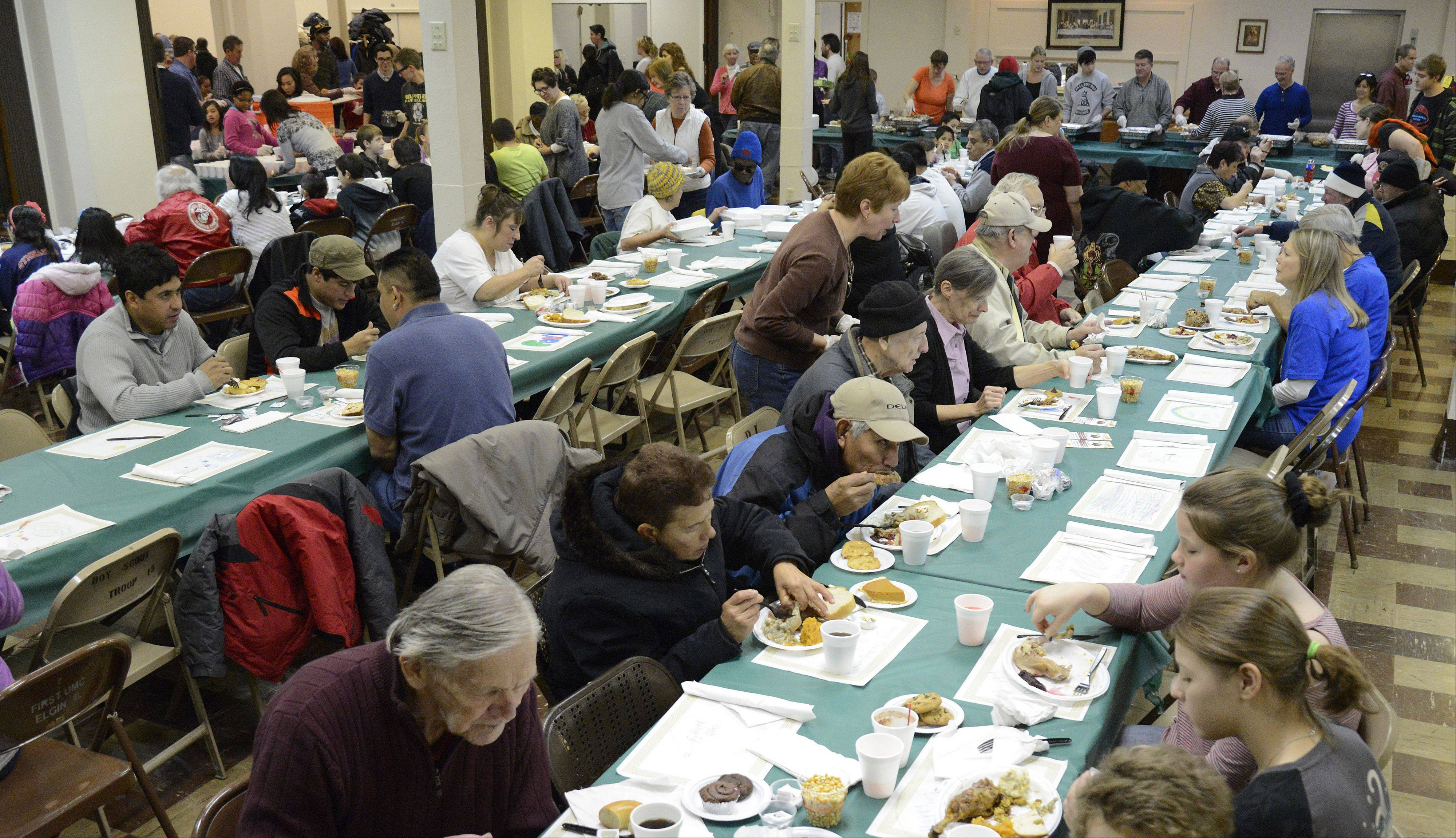 People gather to eat for Thursday's Elgin Community Thanksgiving Dinner at the First United Methodist Church in Elgin.