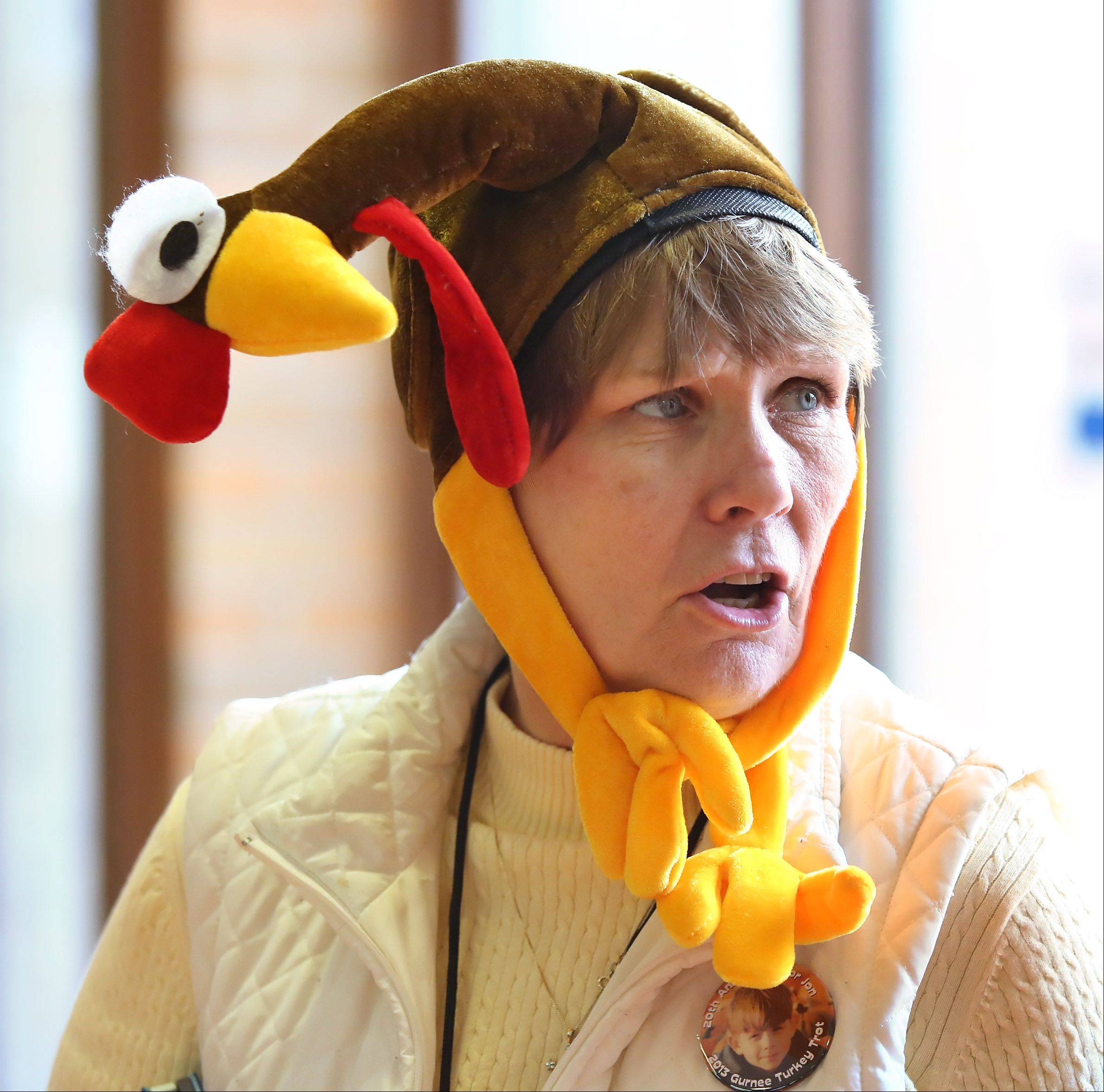 Congregation member Debbie Krueger of Gurnee wears a turkey hat Thursday in Gurnee.