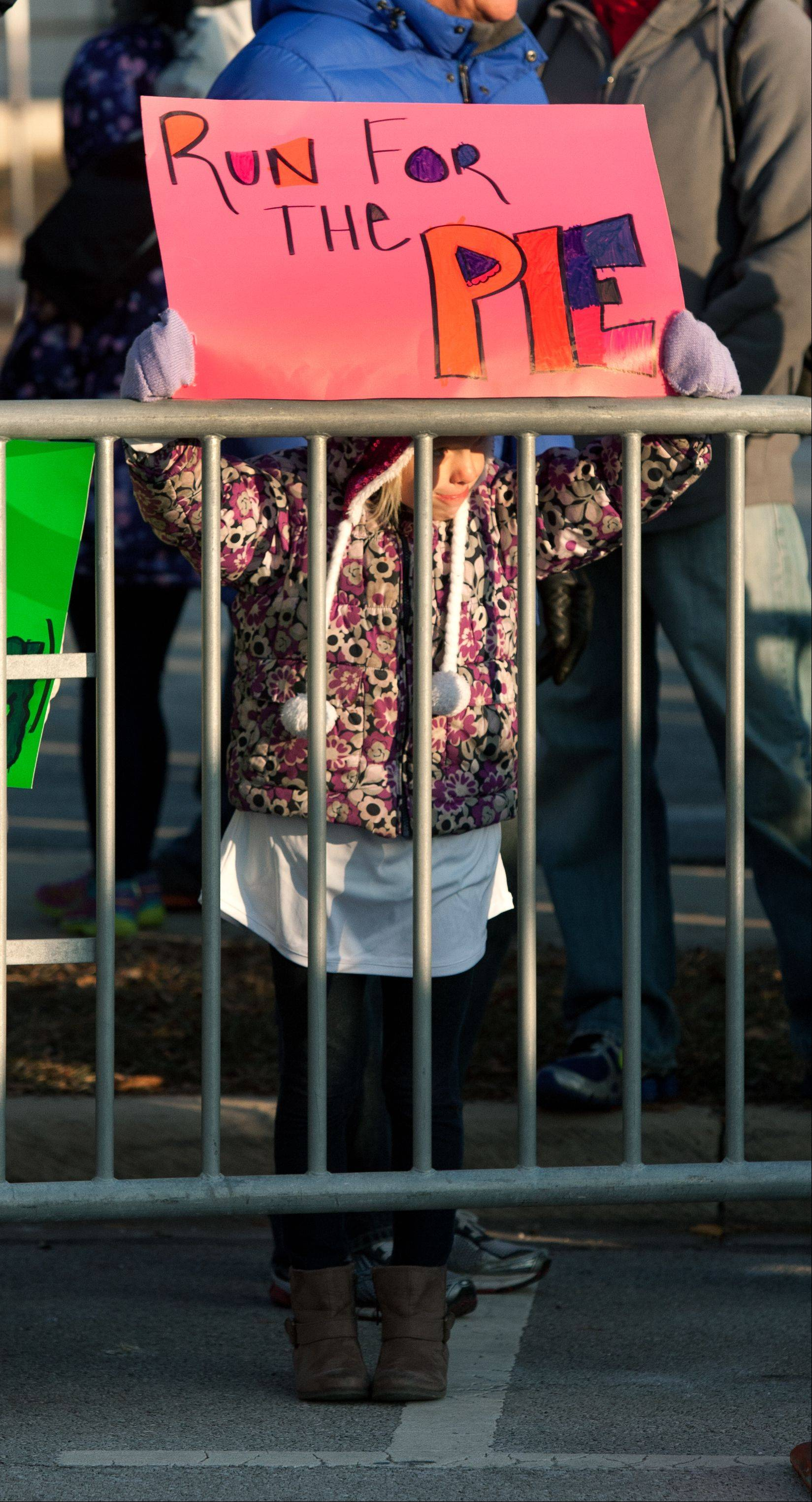 A fan shows her support moments before 7,500 runners take to the streets in the 16th annual Naperville Noon Lions 5K Turkey Trot.