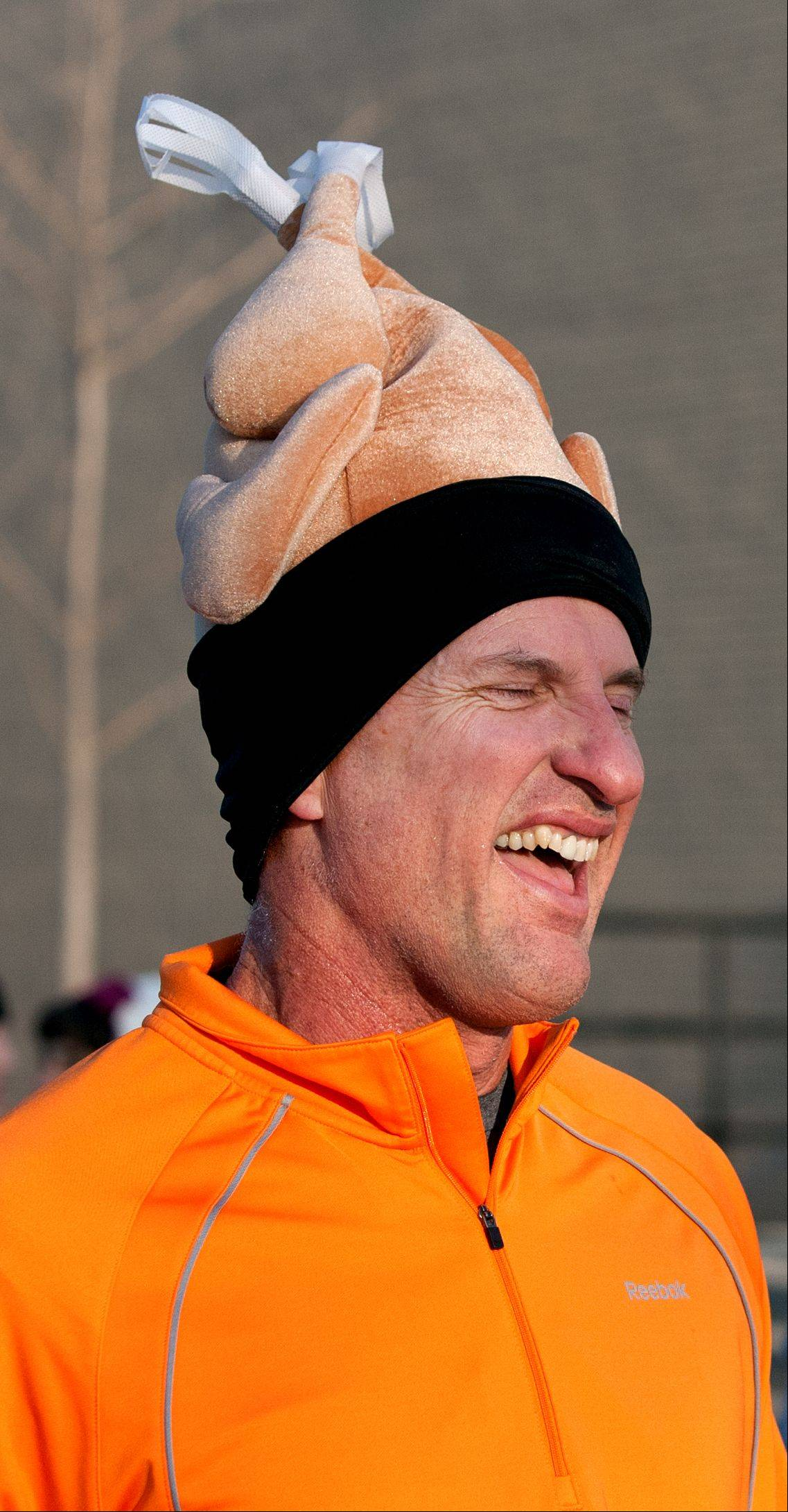 Naperville's Tom Buffington finishes the annual Naperville Noon Lions 5K Turkey Trot Thursday morning.