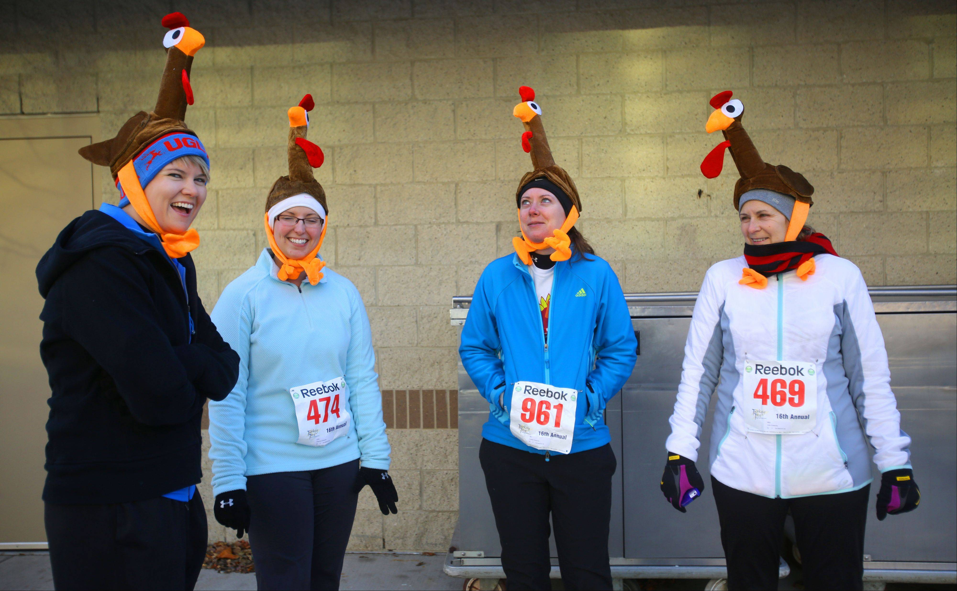 Amber Schieve of Madison, Wis., left, Deanna and Crystal Edwards of Aurora and their mother Julie Edwards, right, of Maple Park. participated in Thursday's Naperville run.