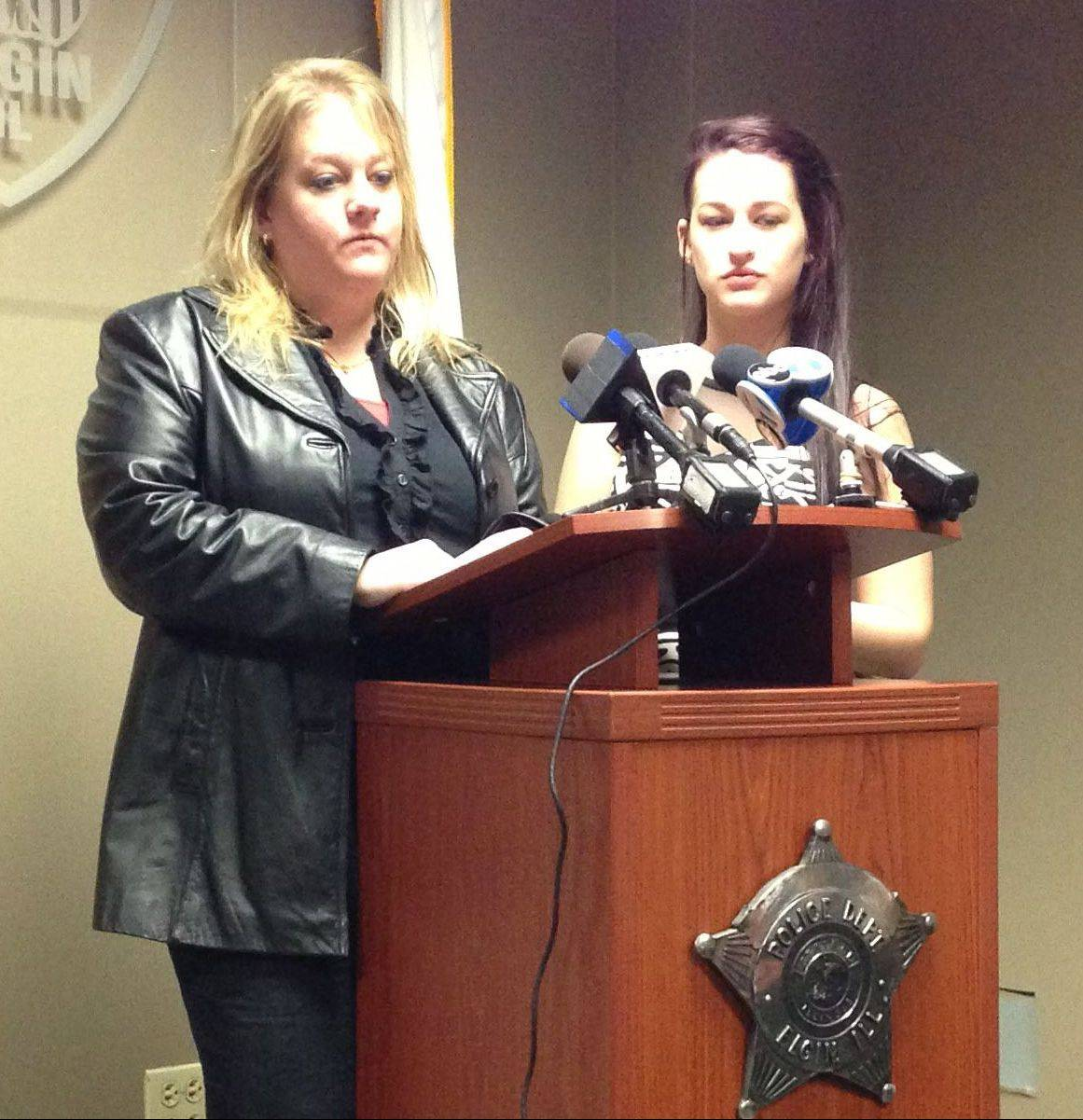 Lonna Zwerenz, left, and her daughter, Alexis, talk about their relative, John Poyer, Thursday at the Elgin Police Department. Poyer was murdered Nov. 22, and Elgin police announced charges against one of his neighbors, Matthew L. Stoecklein.