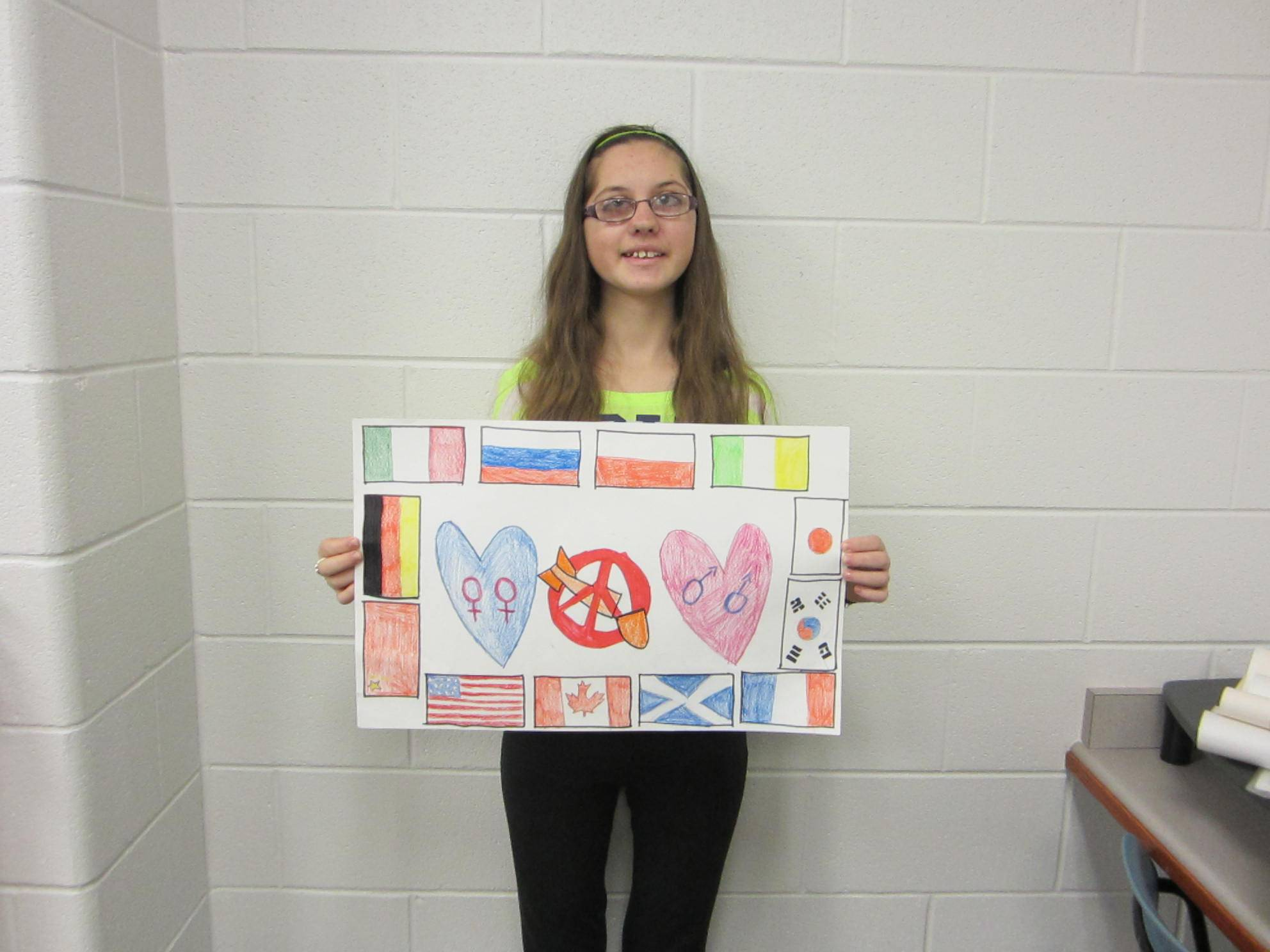 Olivia Cichowals displays her winner poster.
