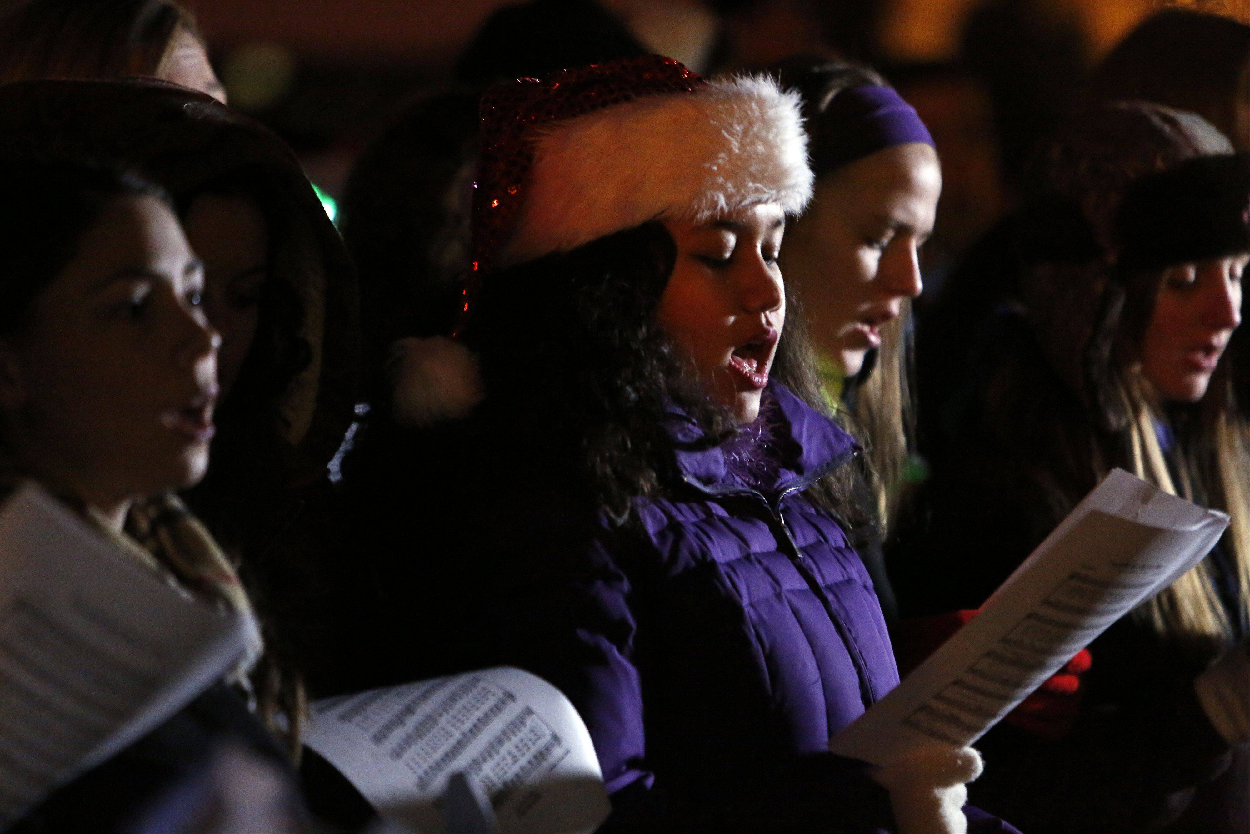Amanda Vallejera, of the combined St. Charles North High School and St. Charles East choirs, belts out a Christmas tune.
